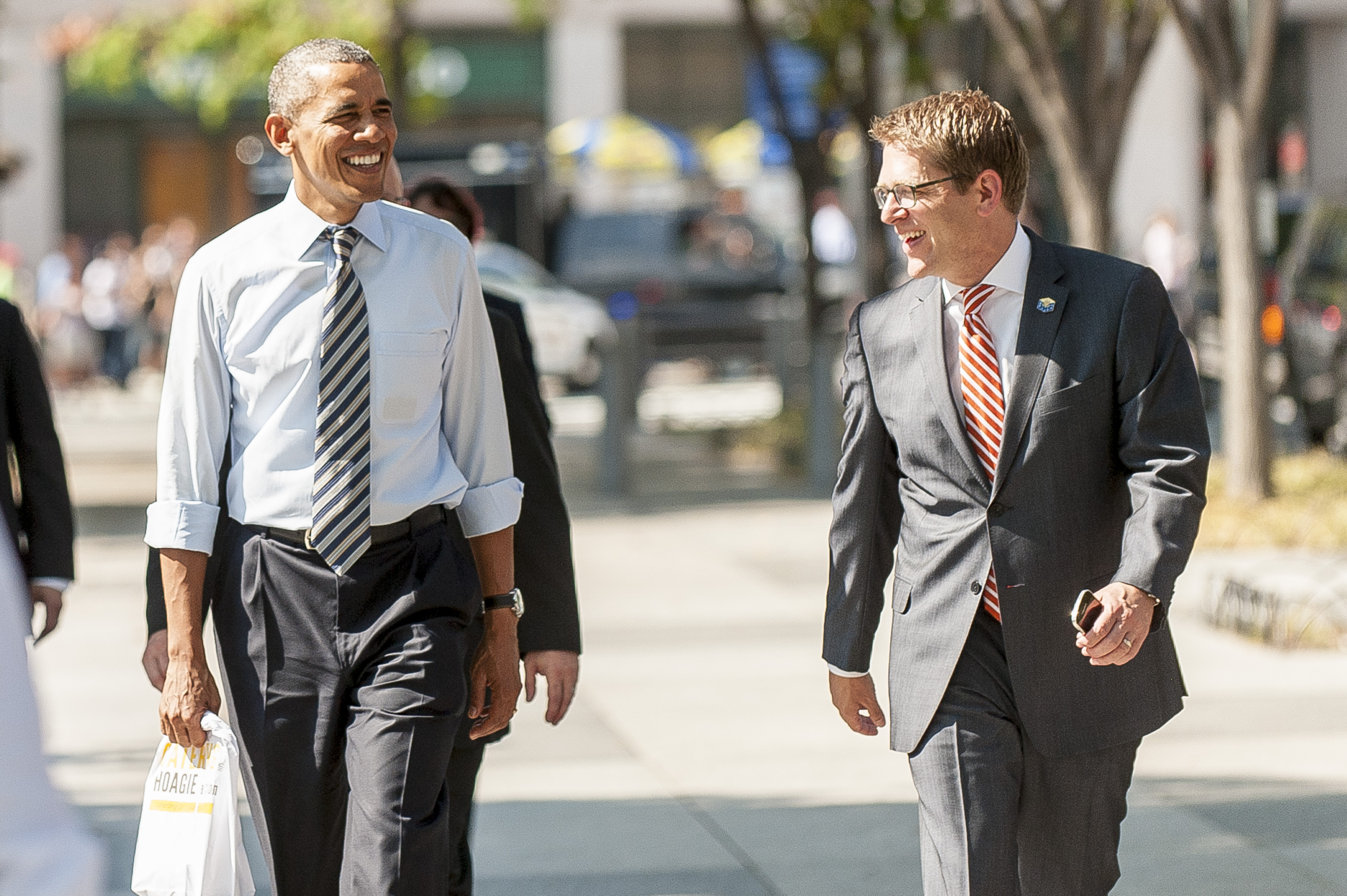United States President Barack Obama and Press Secretary Jay Carney walk back to the White House from nearby Taylor Gourmet Deli on Pennsylvania Avenue after picking up lunch on Oct. 4, 2013 in Washington.