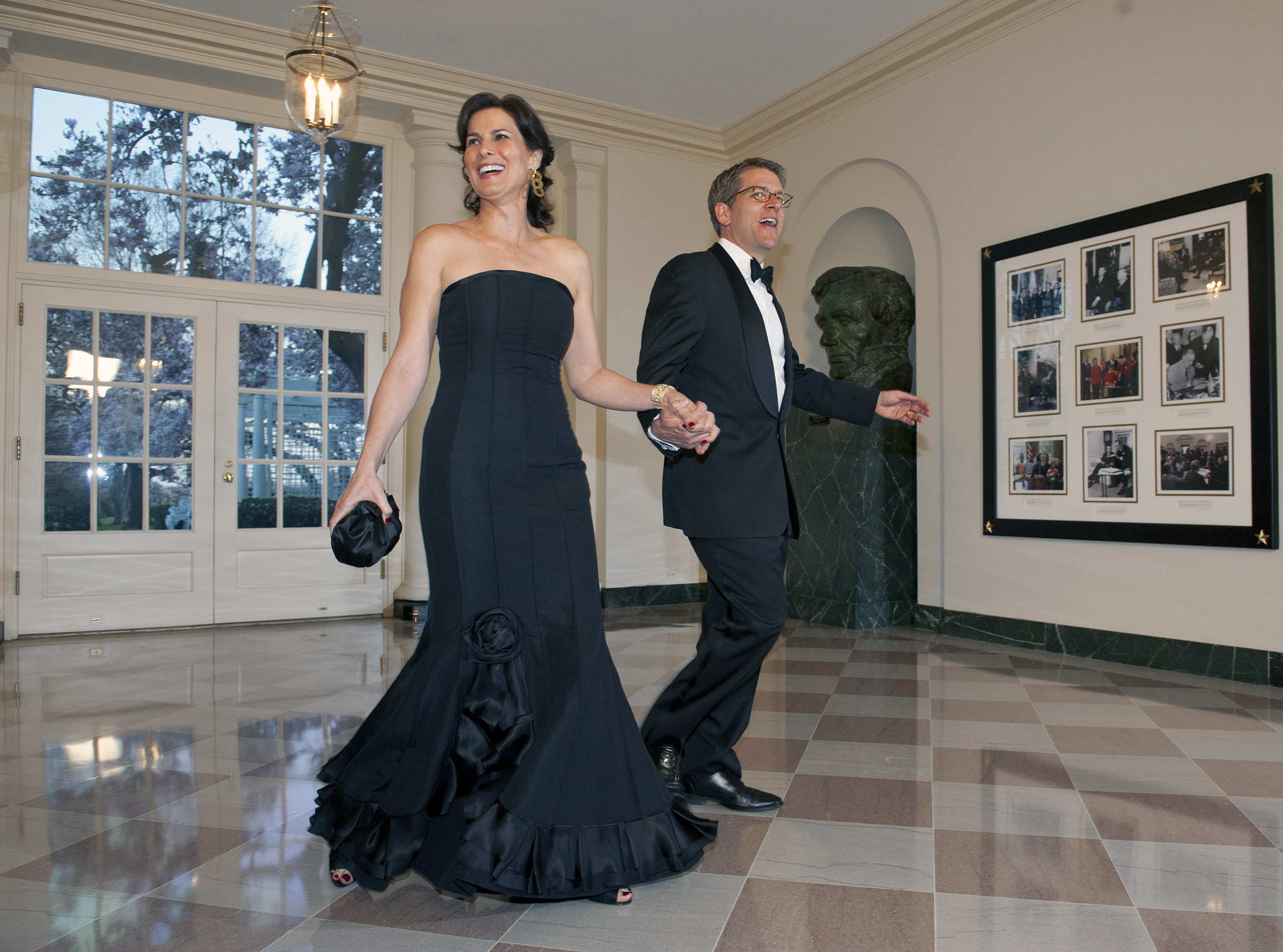 White House press secretary Jay Carney and ABC reporter Claire Shipman arrive for the State dinner for the Prime Minister of Great Britain at the White House on March, 14, 2012 in Washington.