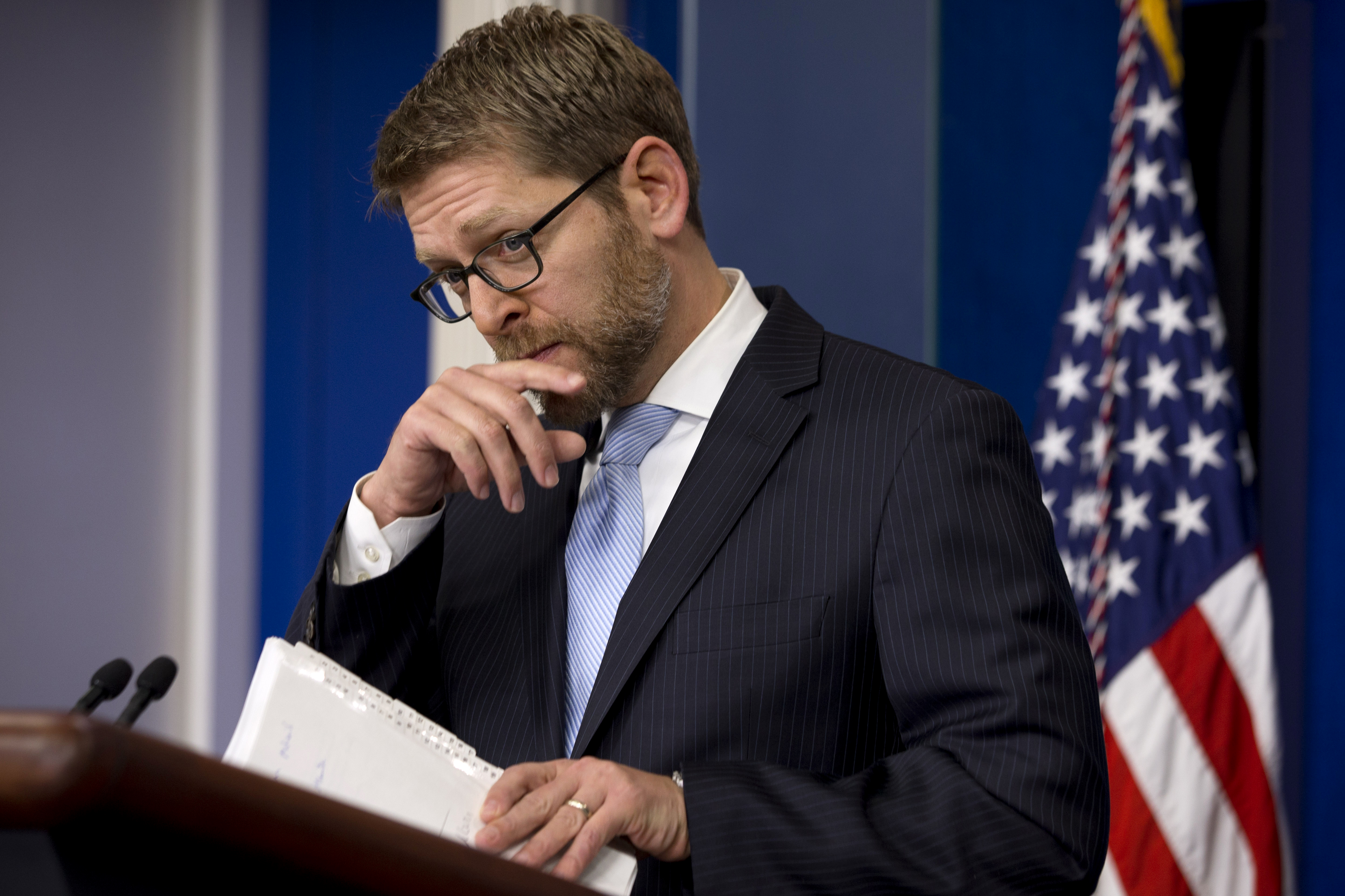 White House press secretary Jay Carney listens to a question about Israel and Secretary of State John Kerry during his daily news briefing at the White House in Washington on Jan. 14, 2014.