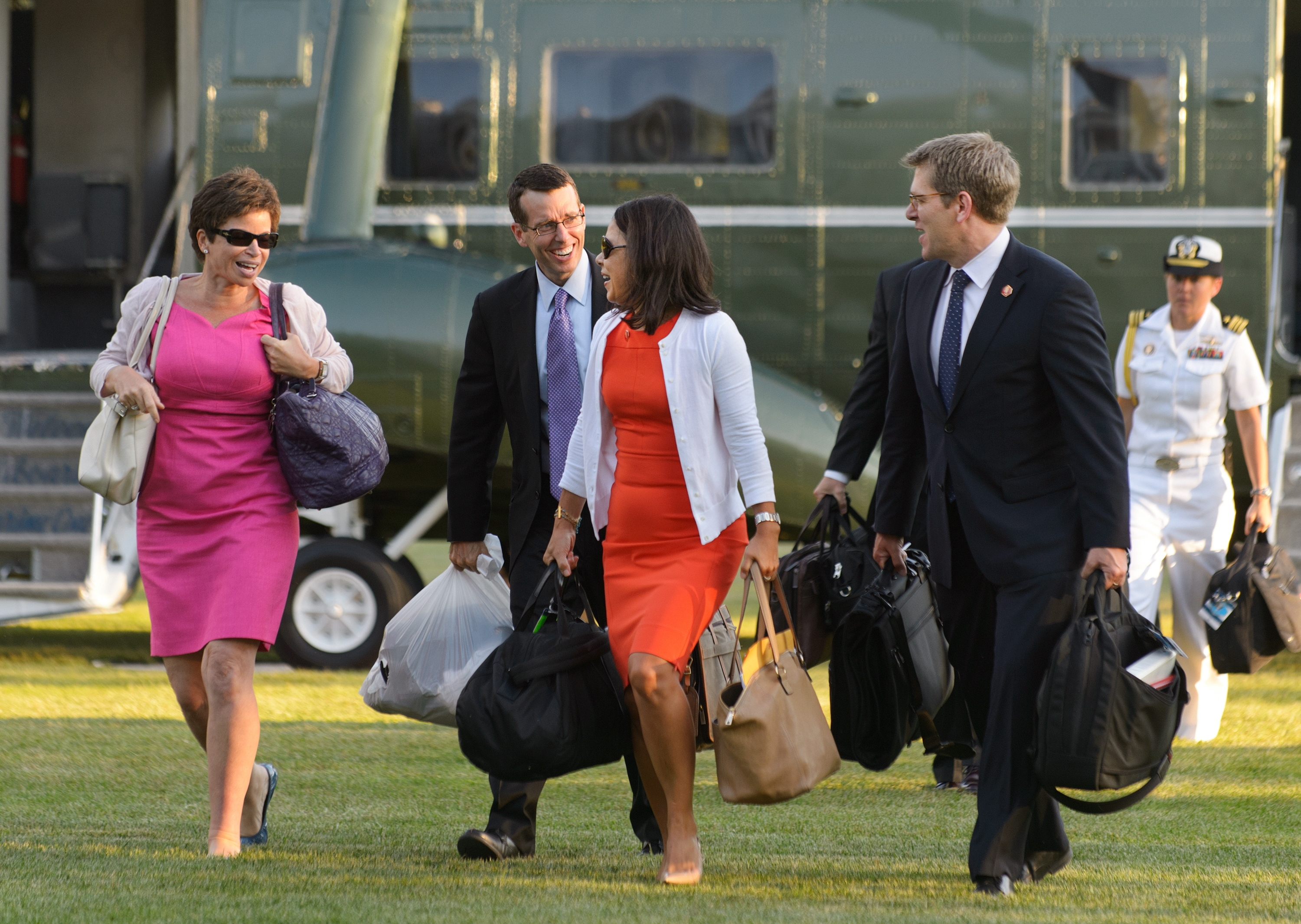 From left: Senior White House Advisors Valerie Jarret, and David Plouffe, White House Deptuy Chief of Staff Nancy Ann DeParle, and White House Press Secretary Jay Carney walk across the South Lawn upon the return to the White House on Augu. 29, 2012 in Washington.