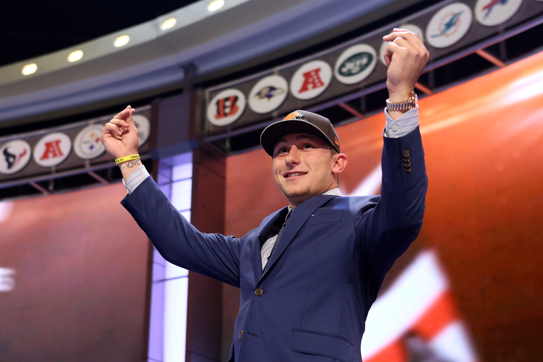 Johnny Manziel gestures on stage after being selected as the number twenty-two overall pick in the first round of the 2014 NFL Draft to the Cleveland Browns at Radio City Music Hall