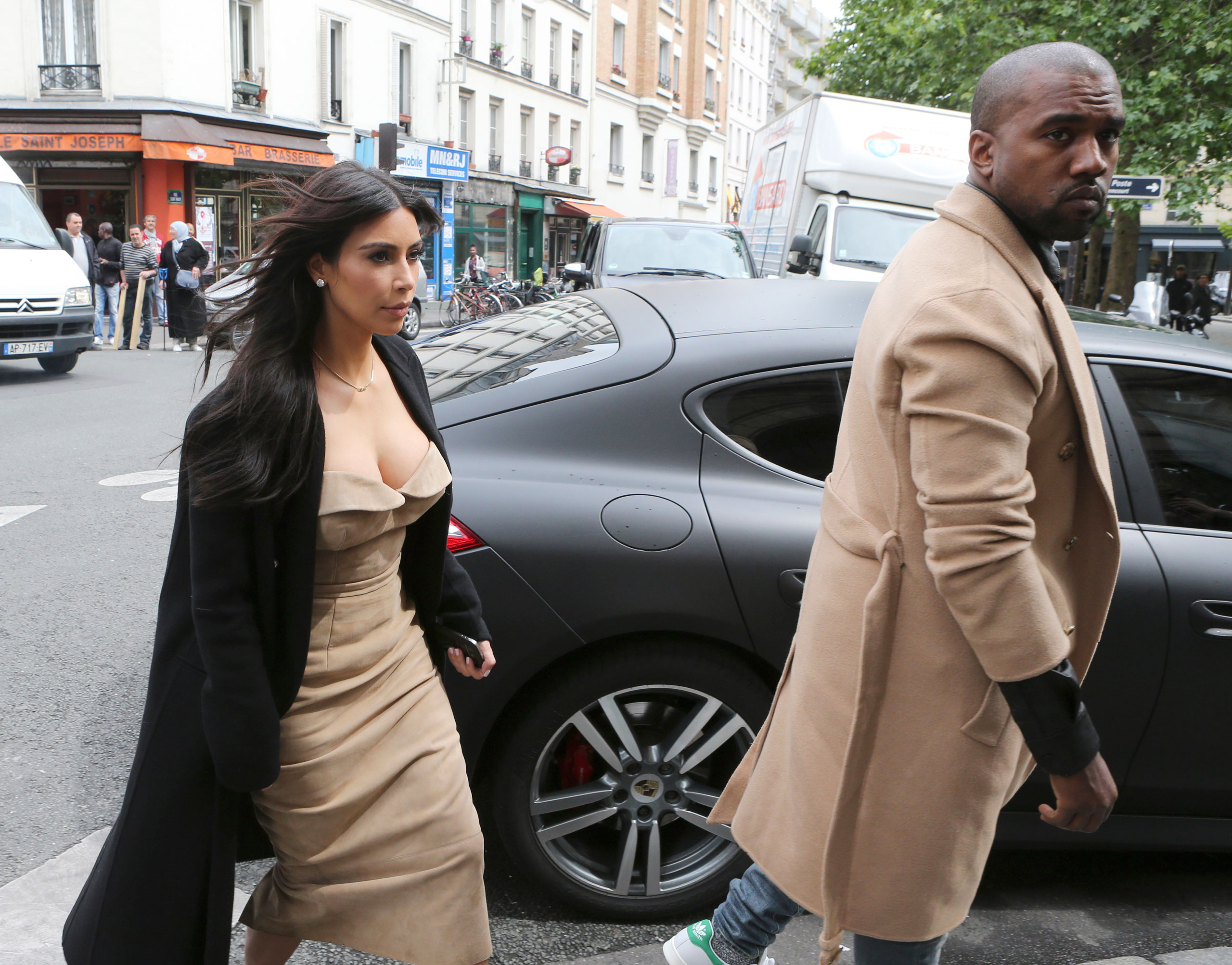 This is Kimye's version of pre-wedding sweatpants in Paris before their fashion-forward nupitals at Forte di Belvedere in Florence in May 2014, where Kim wore a  Givenchy Haute Couture gown.