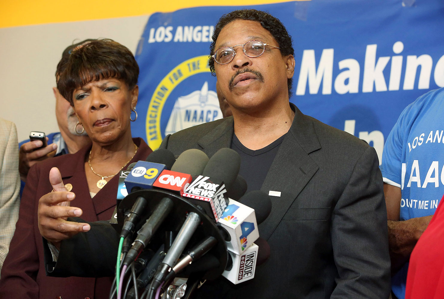 Leon Jenkins, right, president of the Los Angeles chapter of the NAACP, announces that Los Angeles Clippers owner Donald Sterling will not be receiving his lifetime achievement award, at a news conference in Culver City, Calif., April 28, 2014.