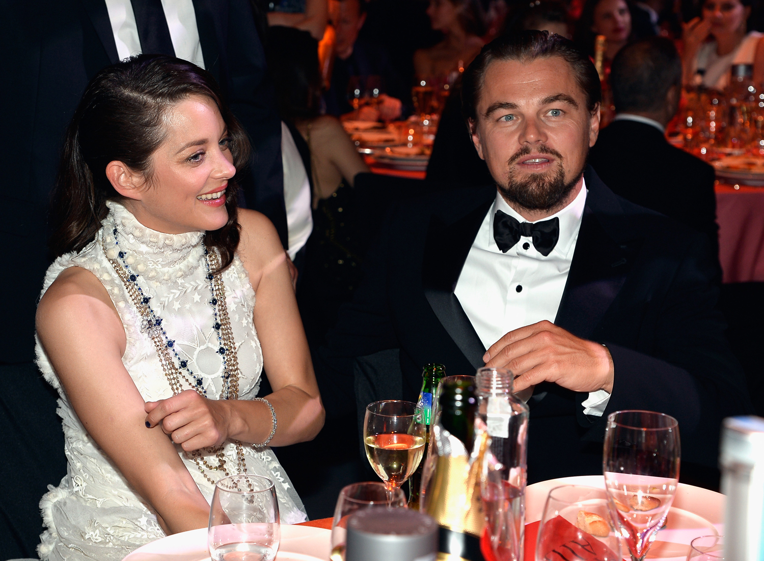 Leonardo DiCaprio and Marion Cotillard attend amfAR's 21st Cinema Against AIDS Gala at Hotel du Cap-Eden-Roc on May 22, 2014 in Cap d'Antibes, France.