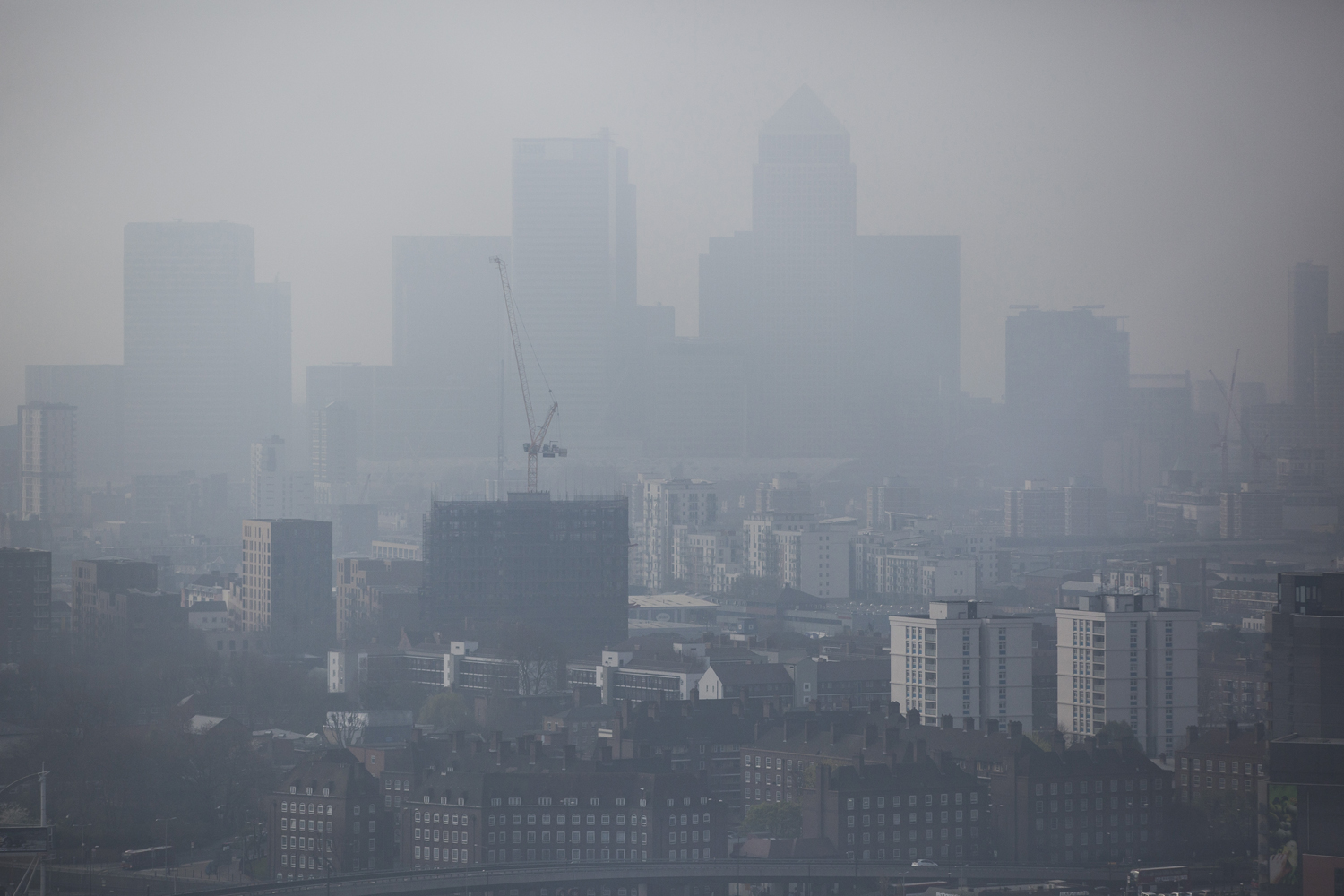 A general view through smog of the Canary Wharf financial district on April 2, 2014 in London.