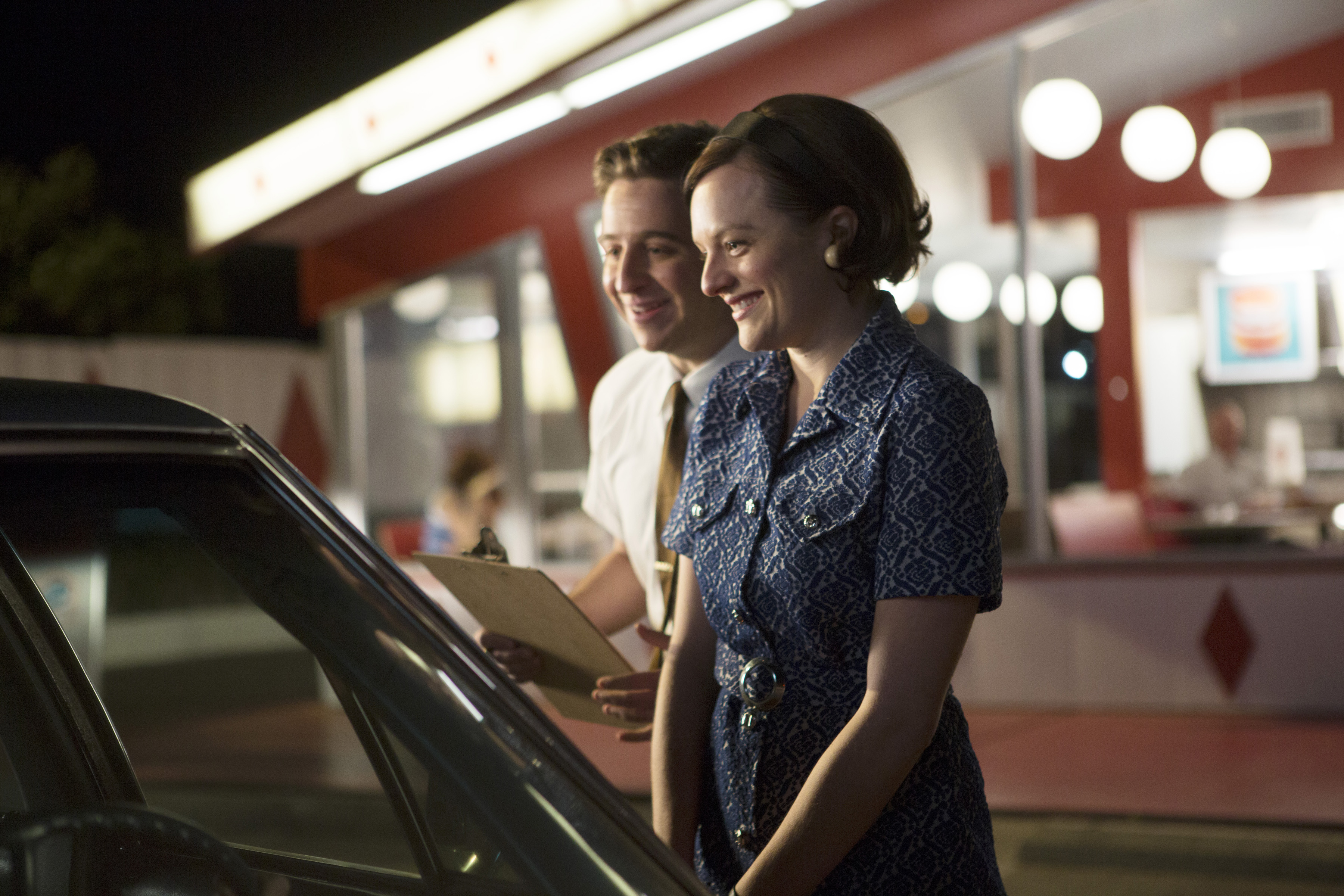 Mathis and Peggy stand outside a Burger Chef franchise.