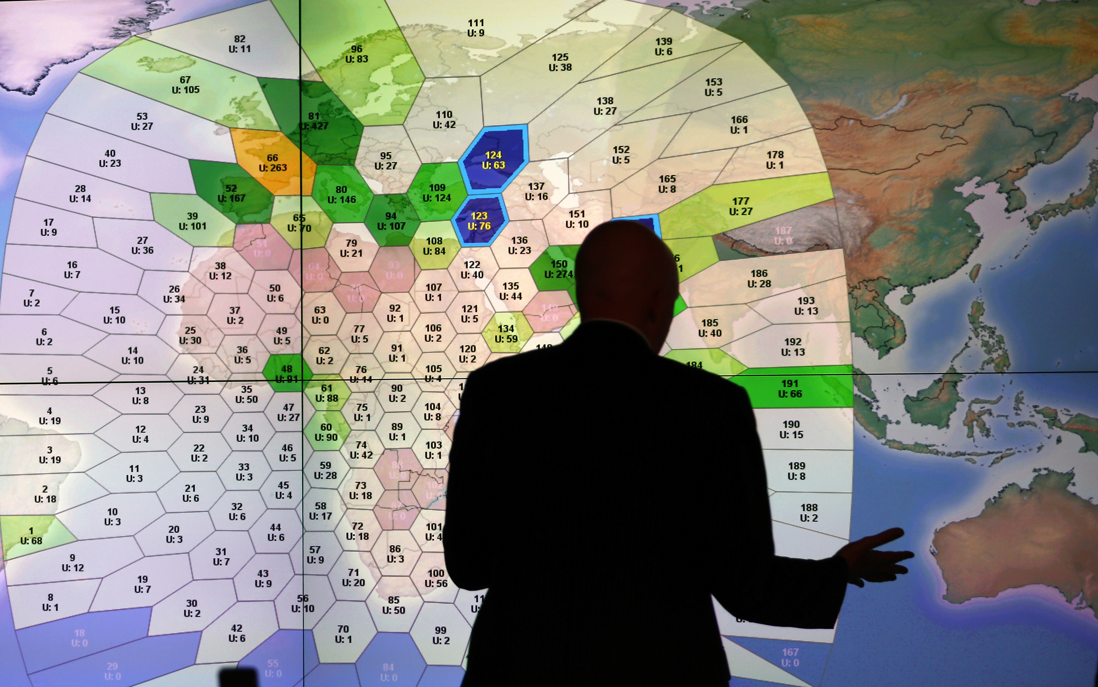 A member of staff at satellite communications company Inmarsat, who helped analyze  pings  via satellite, works in front of a screen showing subscribers using their service throughout the world at their headquarters in London on March 25, 2014.
