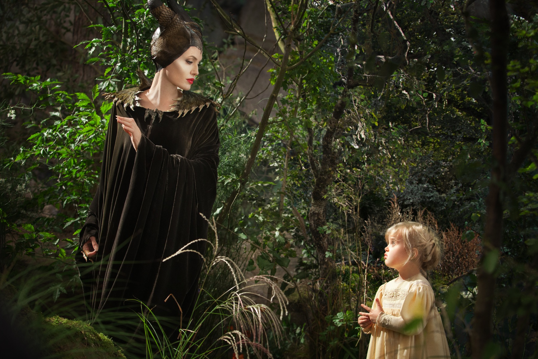 Angelina Jolie as Maleficent, left, in a scene with her daughter Vivienne Jolie-Pitt, portraying Young Aurora, in a scene from   Maleficent.