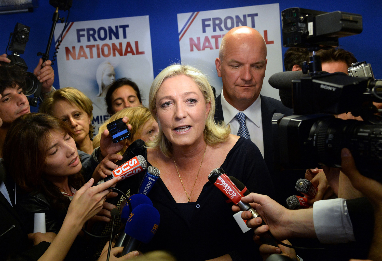 French far-right National Front party president Marine Le Pen reacts at the party's headquarters in Nanterre, outside Paris, on May 25, 2014.