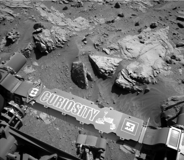 A self-portait taken by Curiosity Rover's Navigation Camera (Navcam) shows a sandstone slab on which the rover team has selected a target, ''Windjana,'' for close-up examination and possible drilling on April 23, 2014.