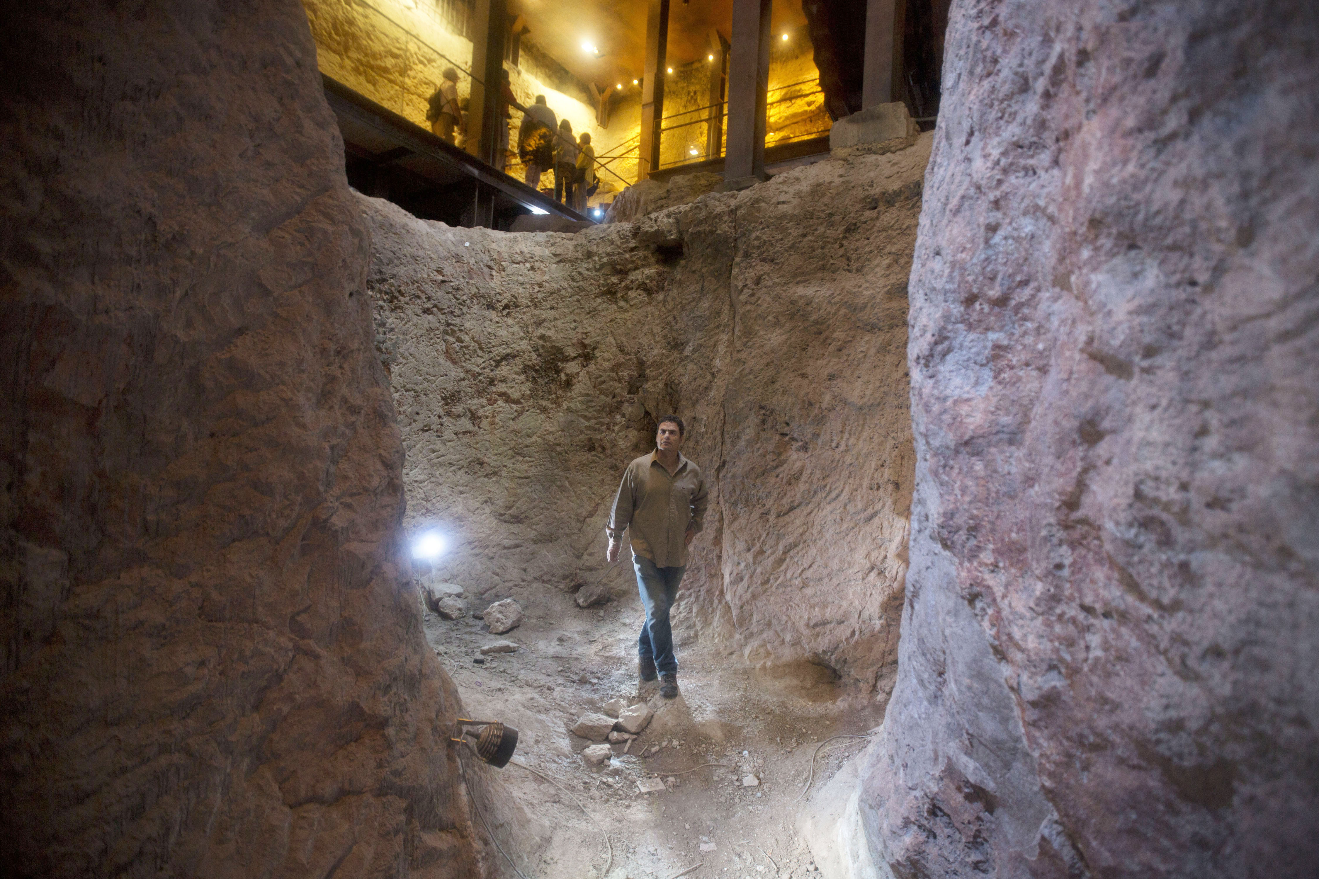 Eli Shukron, an archeologist formerly with Israel's Antiquities Authority, walks in the City of David archaeological site near Jerusalem's Old City.