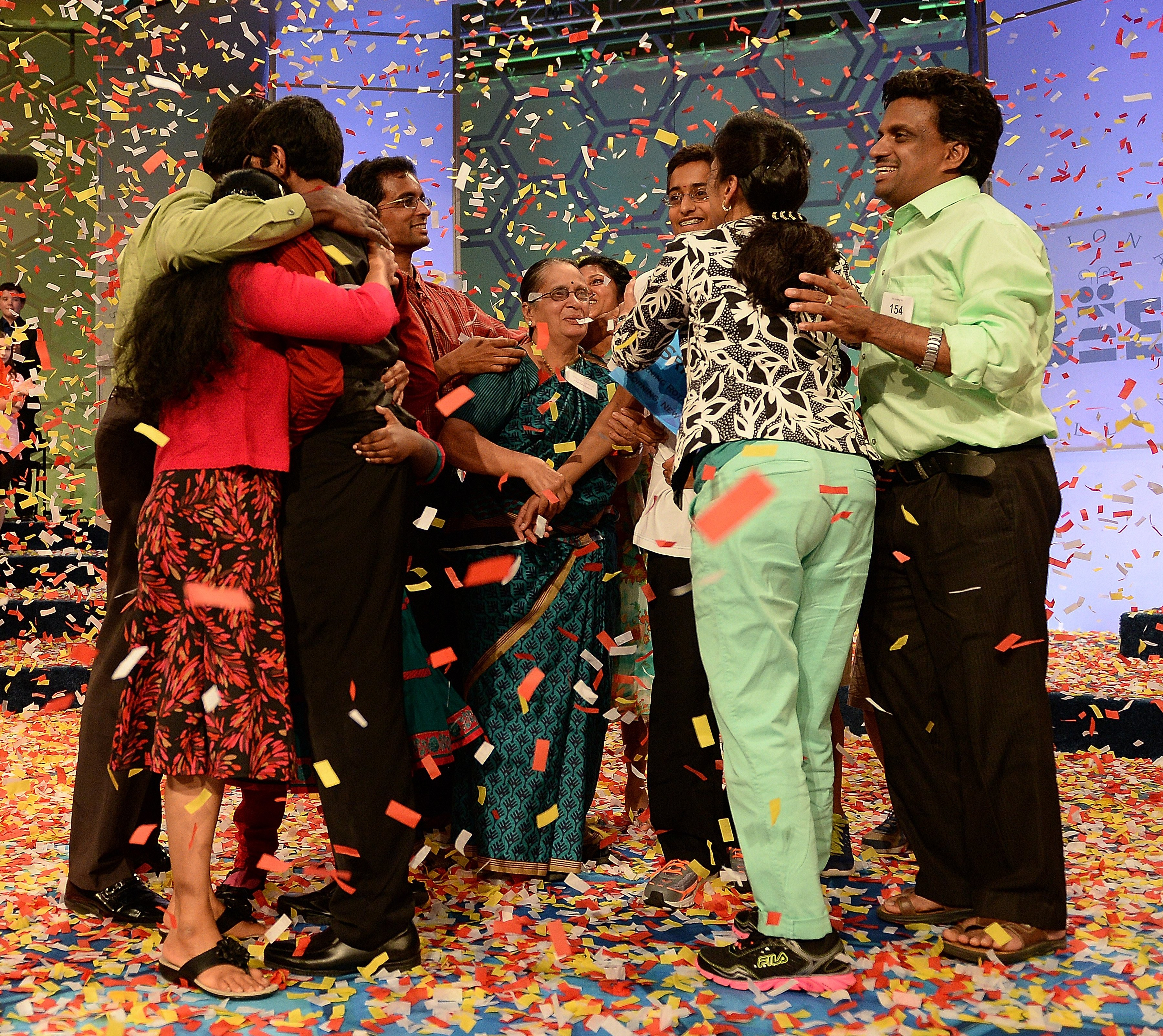 Family members come on stage with spellers Ansun Sujoe, of Fort Worth, left, and Sriram Hathwar, of Painted Post, N.Y., as they celebrate as co-winners of the the 2014 Scripps National Spelling Bee in National Harbor, Md. on May 29, 2014.