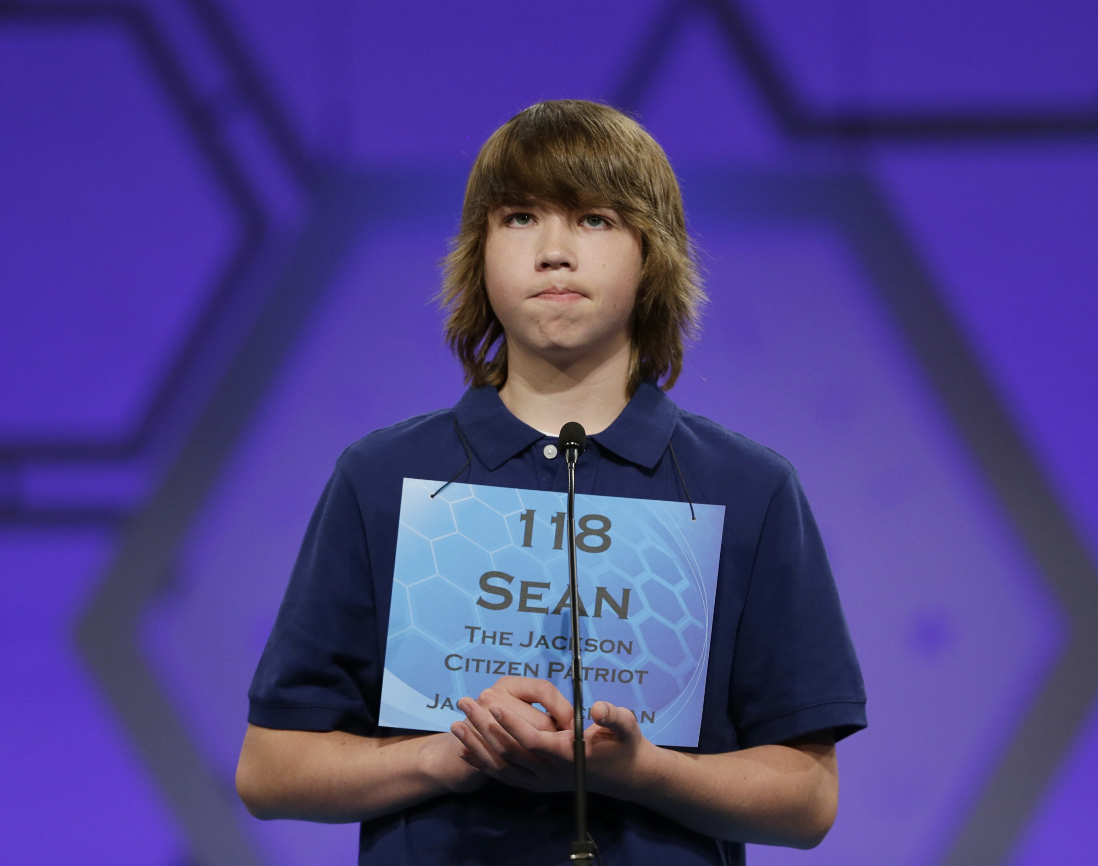 Sean Hickey of Grass Lake, Mass. reacts as he misspells his word during round two of the preliminaries at the Scripps-Howard National Spelling Bee at National Harbor, Md. on May 28, 2014.