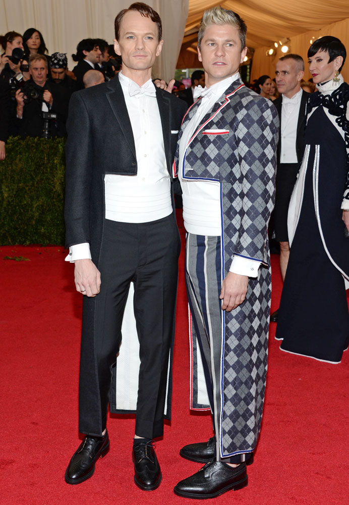 From left: Neil Patrick Harris and David Burtka attend The Metropolitan Museum of Art's Costume Institute benefit gala celebrating  Charles James: Beyond Fashion  on May 5, 2014, in New York City.