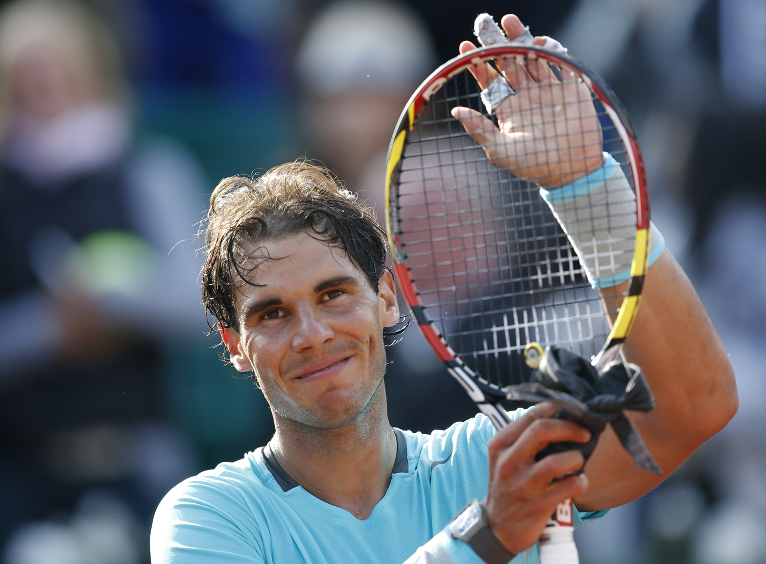 Rafael Nadal of Spain reacts after defeating Robby Ginepri of the U.S. in their men's singles match at the French Open tennis tournament at the Roland Garros stadium in Paris May 26, 2014.