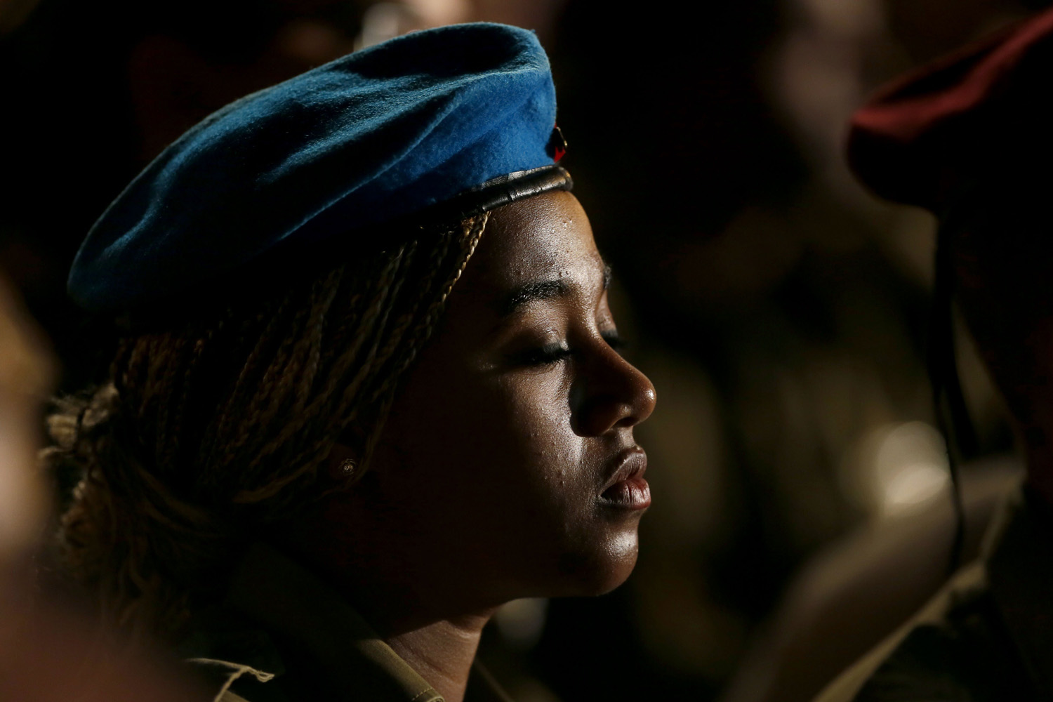 May 4, 2014. An Israeli soldier stands to attention at the start of Remembrance Day for fallen soldiers during a state ceremony at the Western Wall in Jerusalem's Old City.