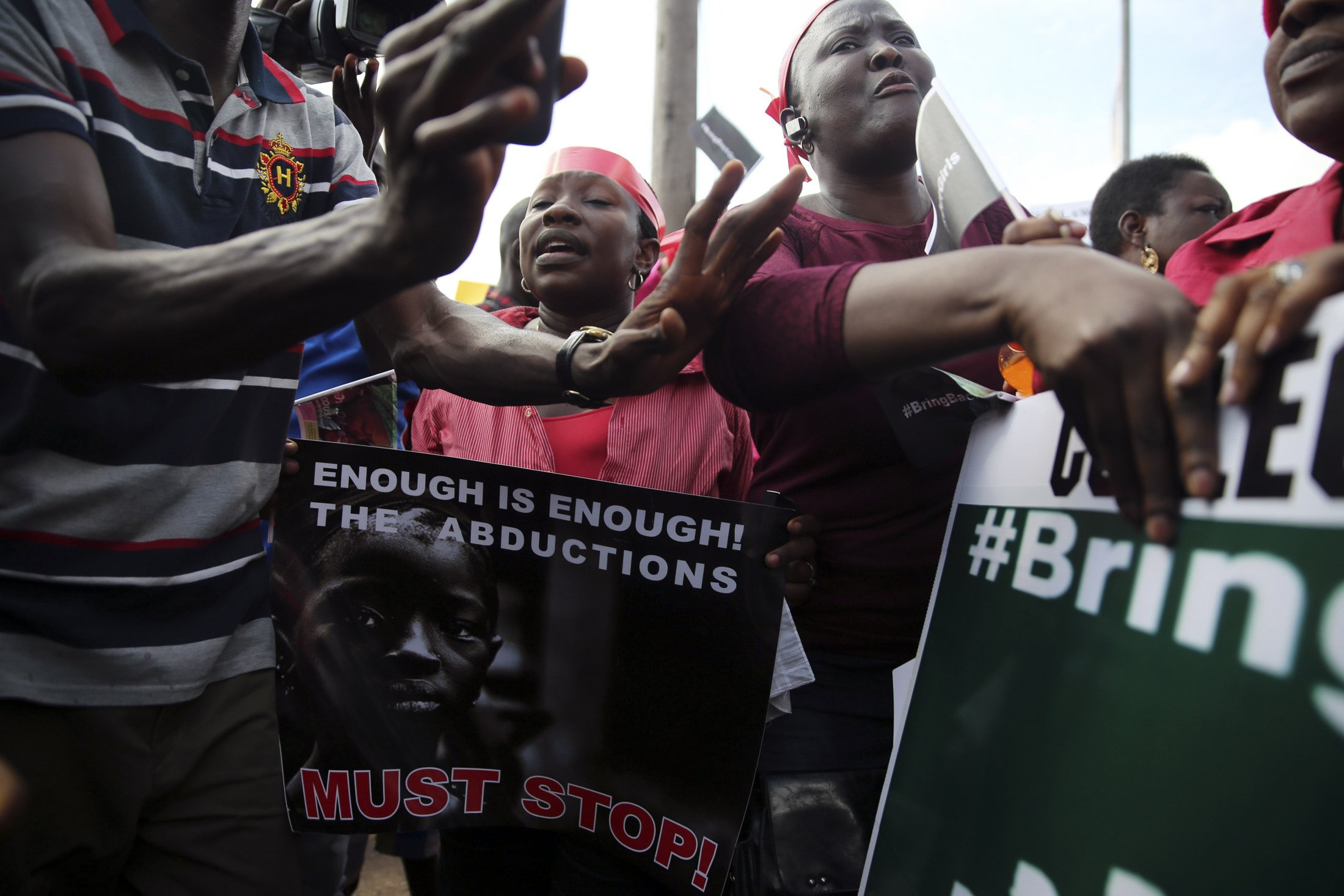 People holding signs take part in a protest demanding the release of abducted secondary school girls from the remote village of Chibok, in Lagos, May 5, 2014.