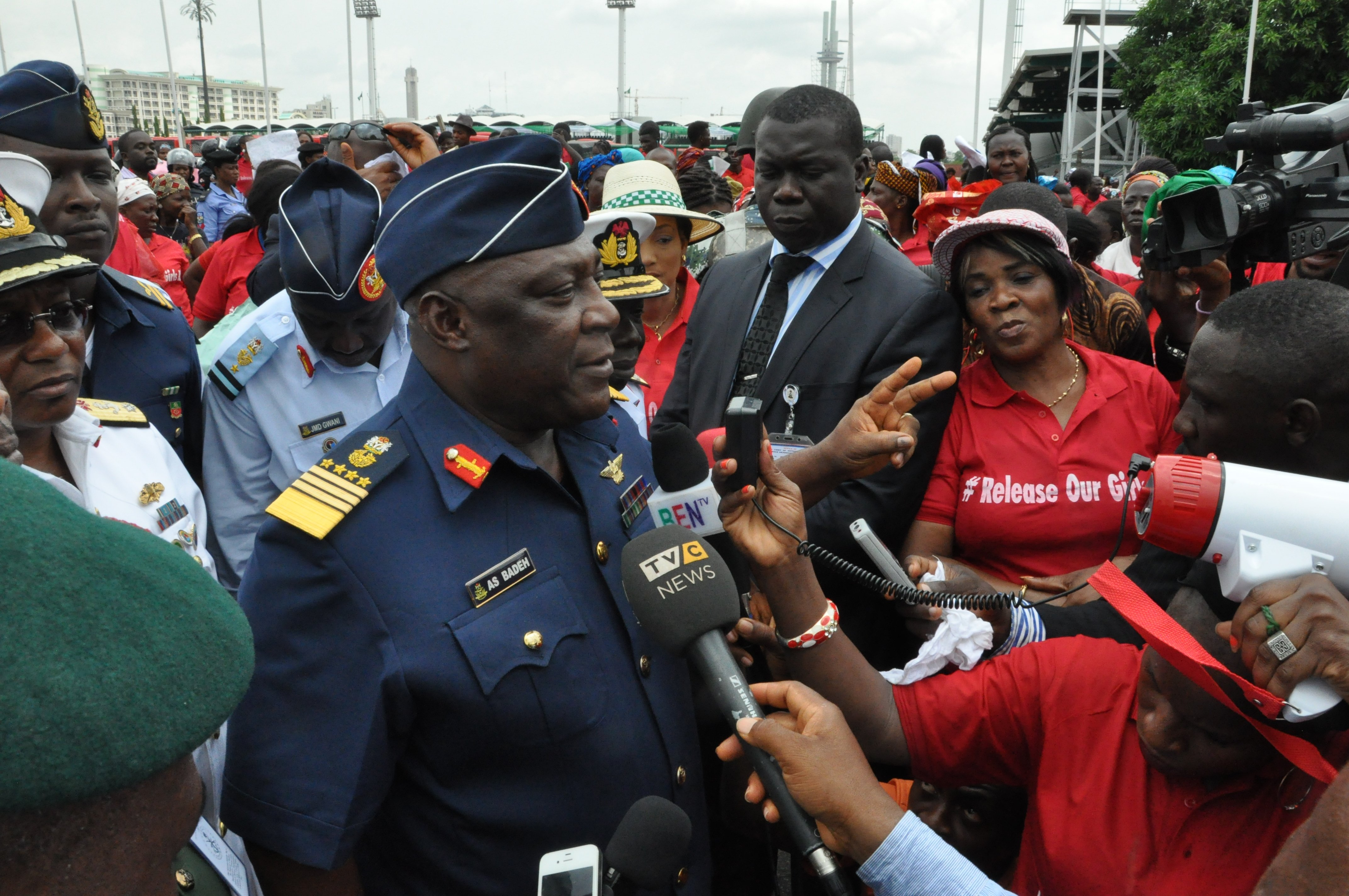 Nigeria defence chief Air Marshal Alex Badeh, center, speaks during a demonstration calling on the government to rescue the kidnapped schoolgirls on May 26, 2014, in the Nigerian capital, Abuja
