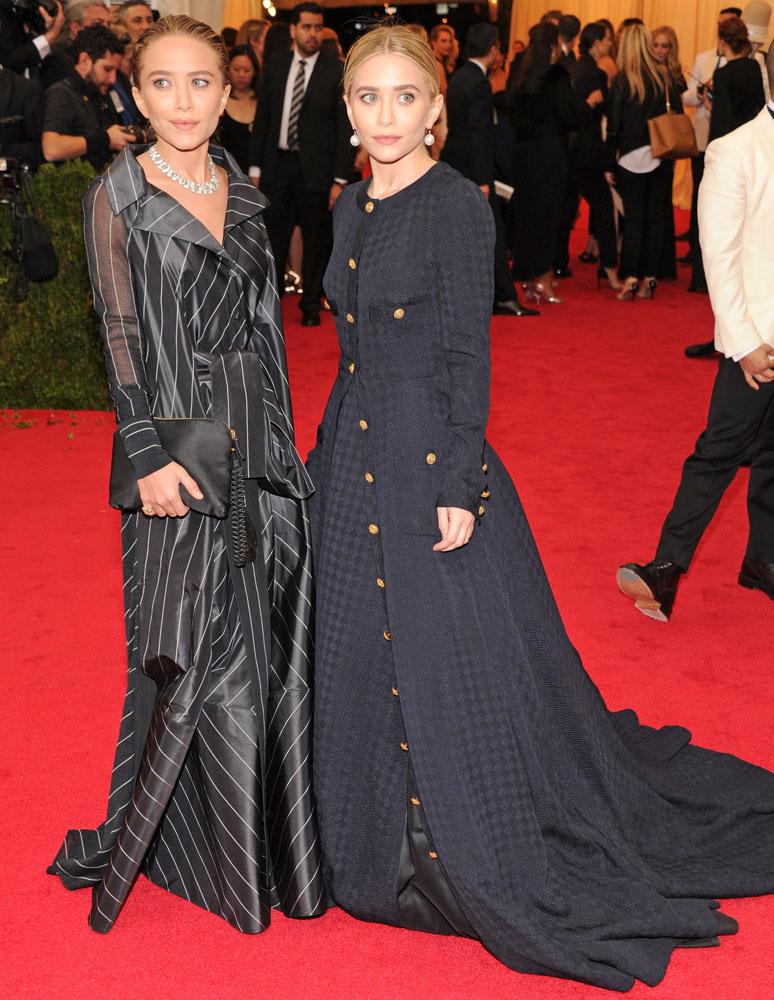 From left: Mary-Kate and Ashley Olsen attend The Metropolitan Museum of Art's Costume Institute benefit gala celebrating  Charles James: Beyond Fashion  on May 5, 2014, in New York City.