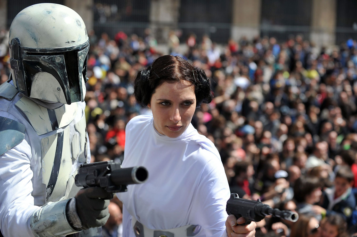 A member of the Star Wars fan club dressed as Princess Leia celebrates  Star Wars Day  in front of the Colosseum in central Rome on May 4, 2014.