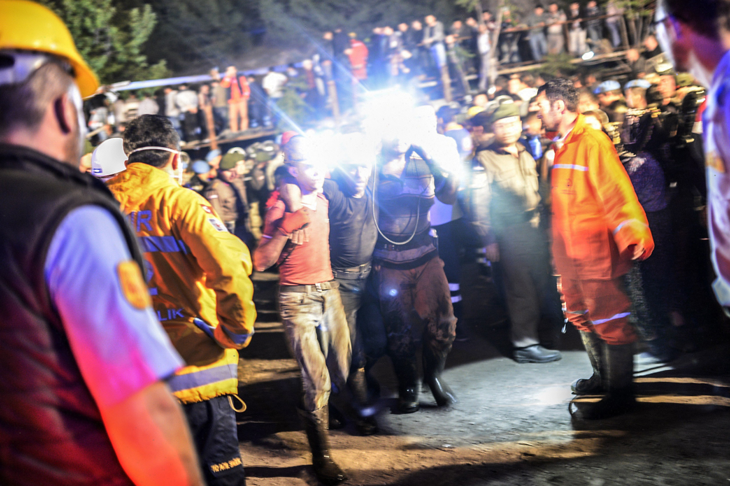 A miner is helped by friends after an explosion in a coal mine in Manisa, Turkey, May 13, 2014.