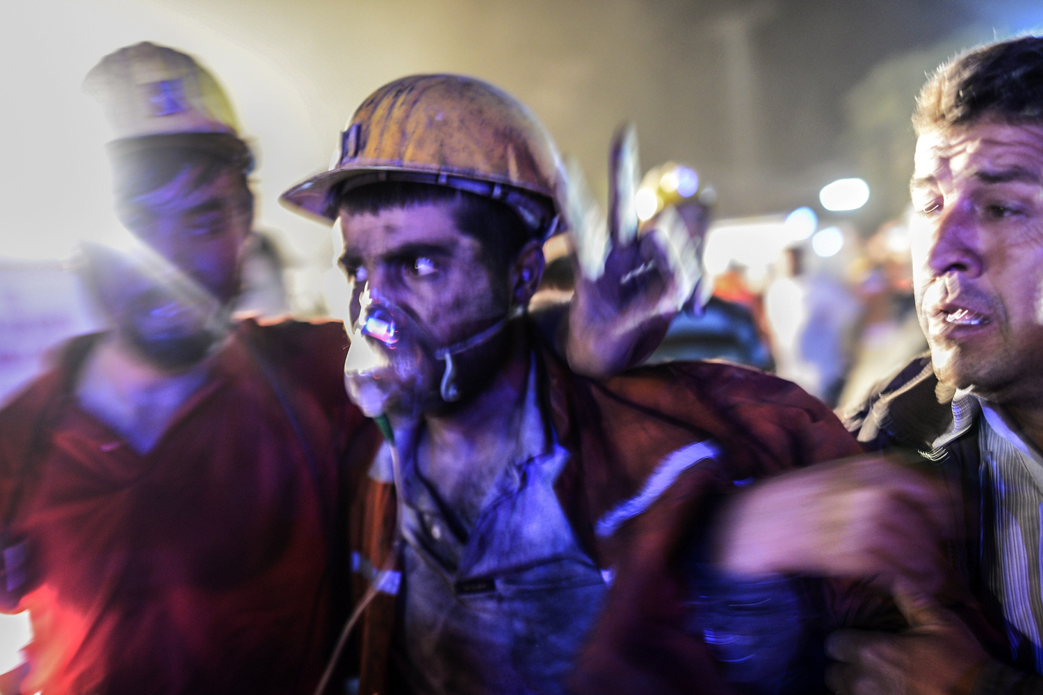May 13, 2014. An injured miner came out carried by rescuers, on  after an explosion in a coal mine in Manisa.