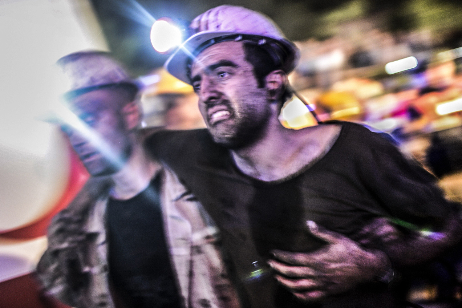 An injured miner is carried by rescuers after an explosion in a coal mine in Manisa, Turkey, May 13, 2014.