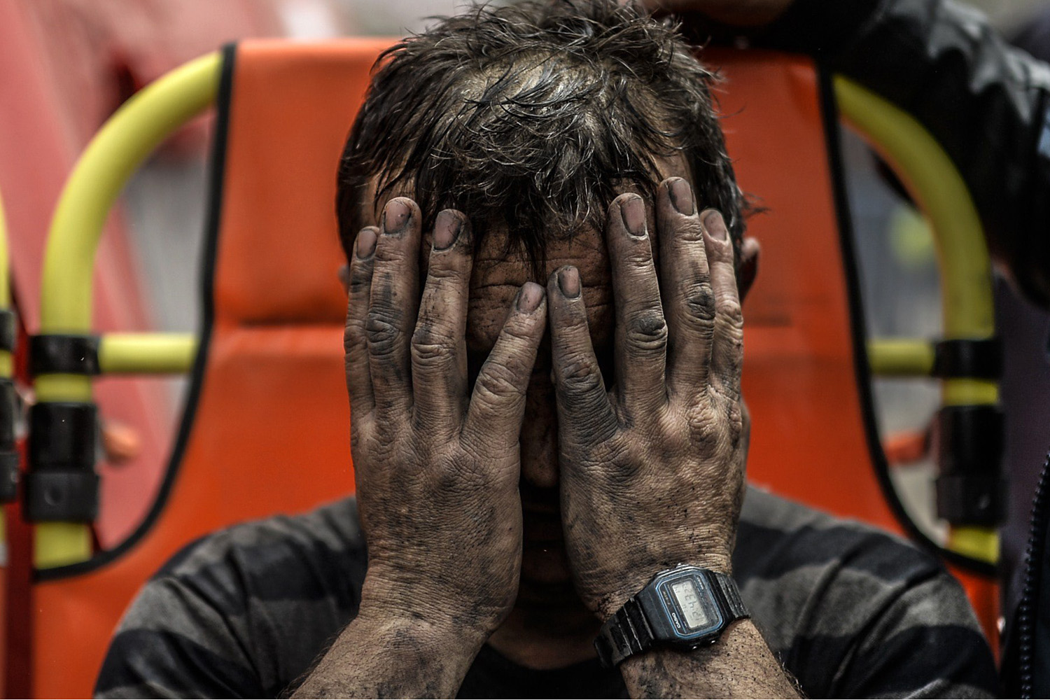 A miner reacts after being affected with toxic gas while searching for co-workers who remain trapped underground the western Turkish province of Manisa, May 14, 2014.