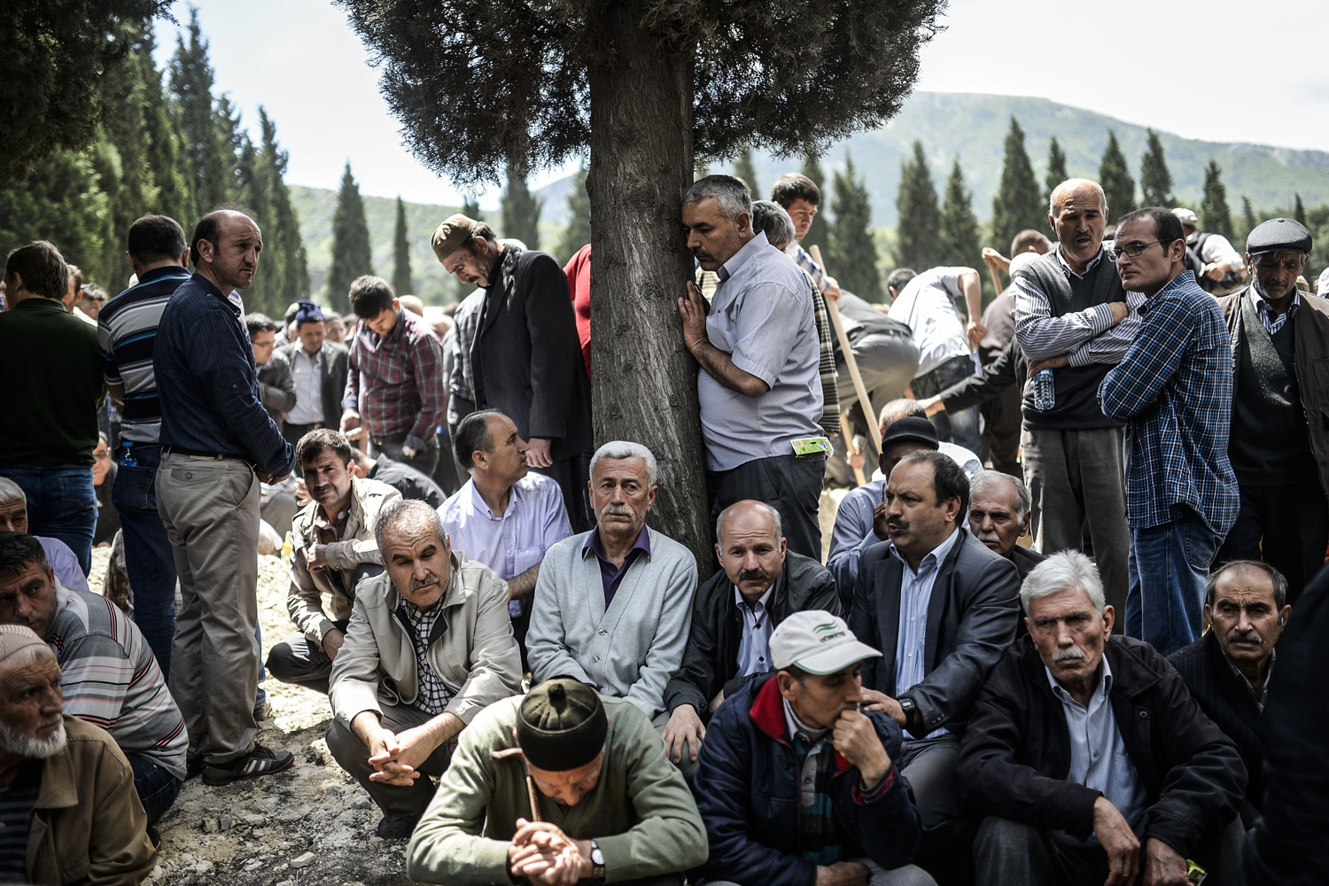 May 15, 2014. People mourn in a cemetery during the funeral ceremony of miners who died in an explosion on  in the western town of Soma in Manisa, Turkey.