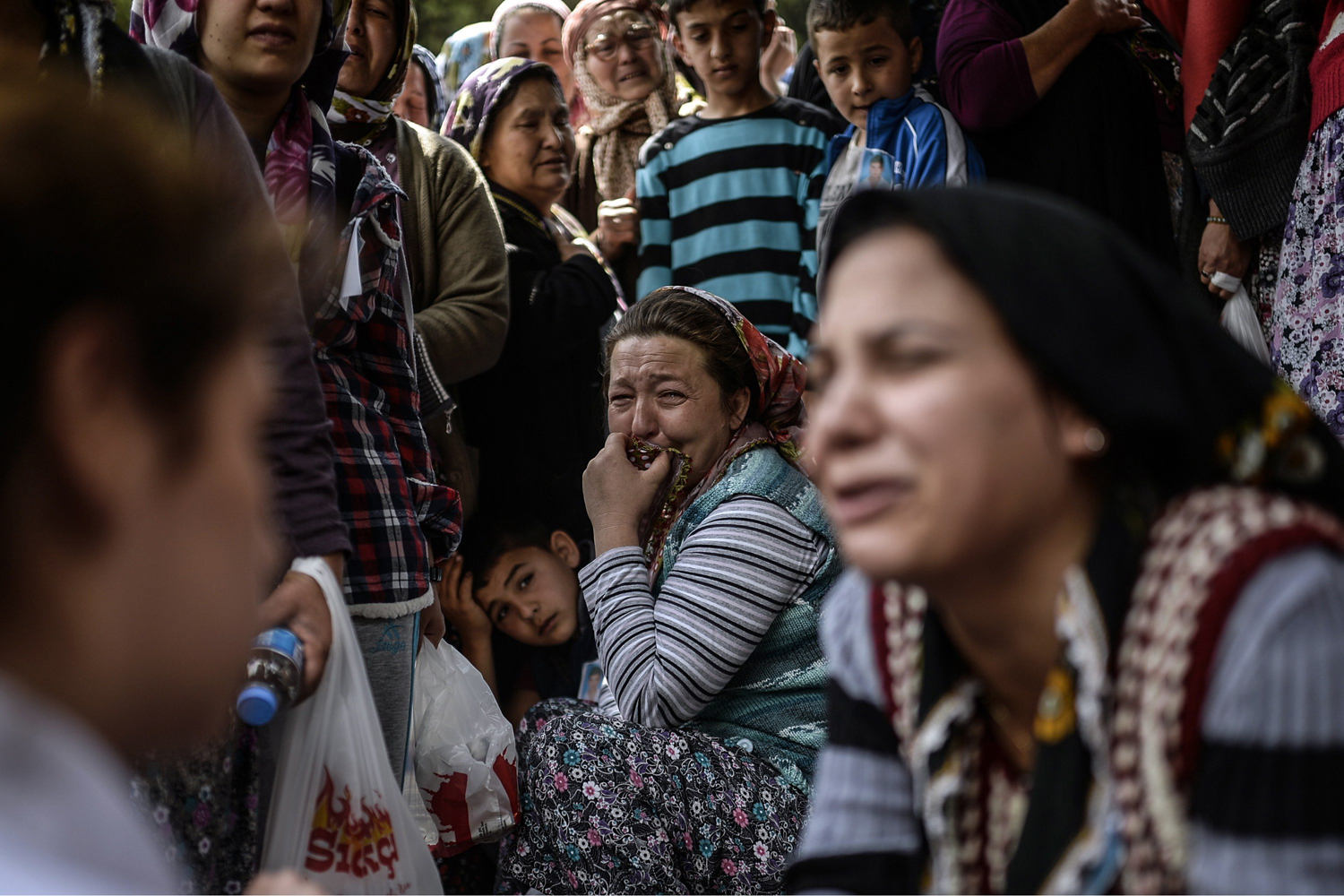 People cry during a funeral ceremony for miners who died in an explosion in western Turkish province of Manisa, May 15, 2014.