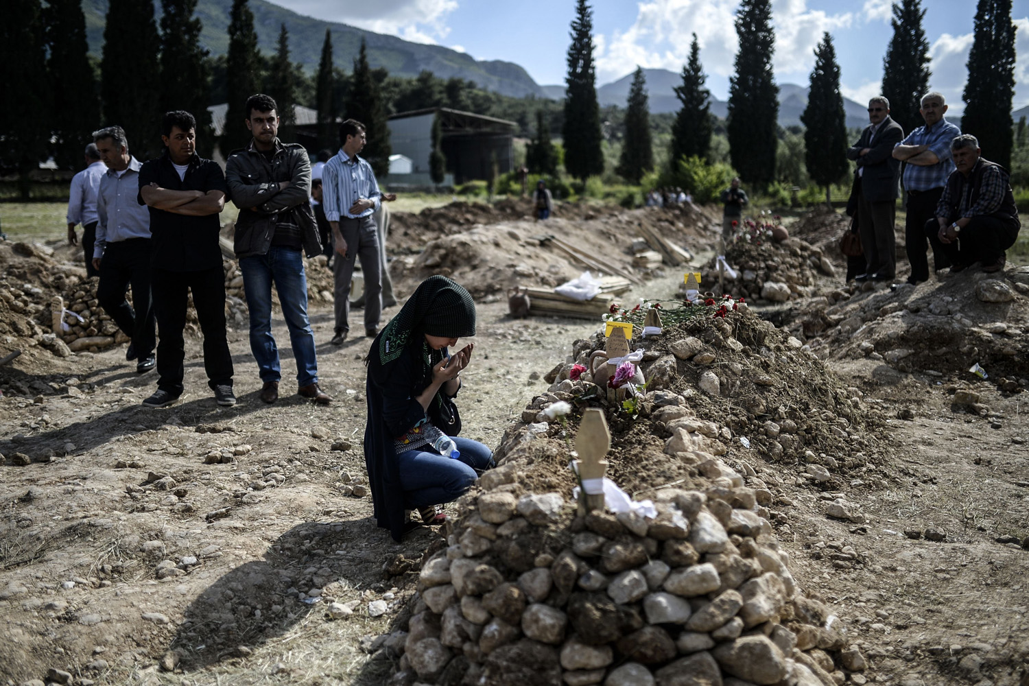 A woman prays for miners during a funeral at Soma in Manisa, Turkey, May 15, 2014 .