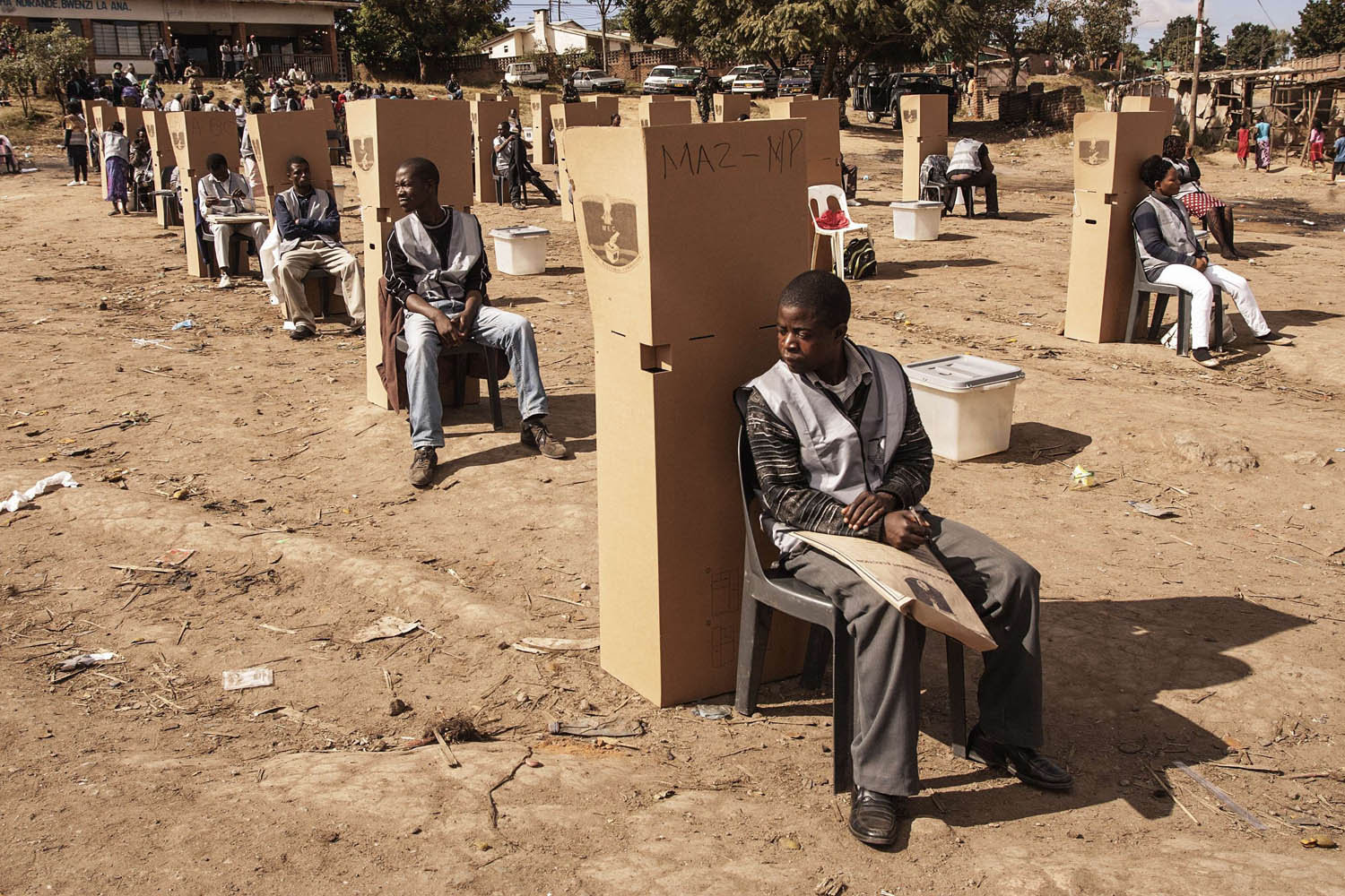 May 21, 2014. Malawian Electoral Commission workers and officers sit near the polling booths as voting procedures are repeated in Ndirande after polling was disrupted yesterday in Blantyre.