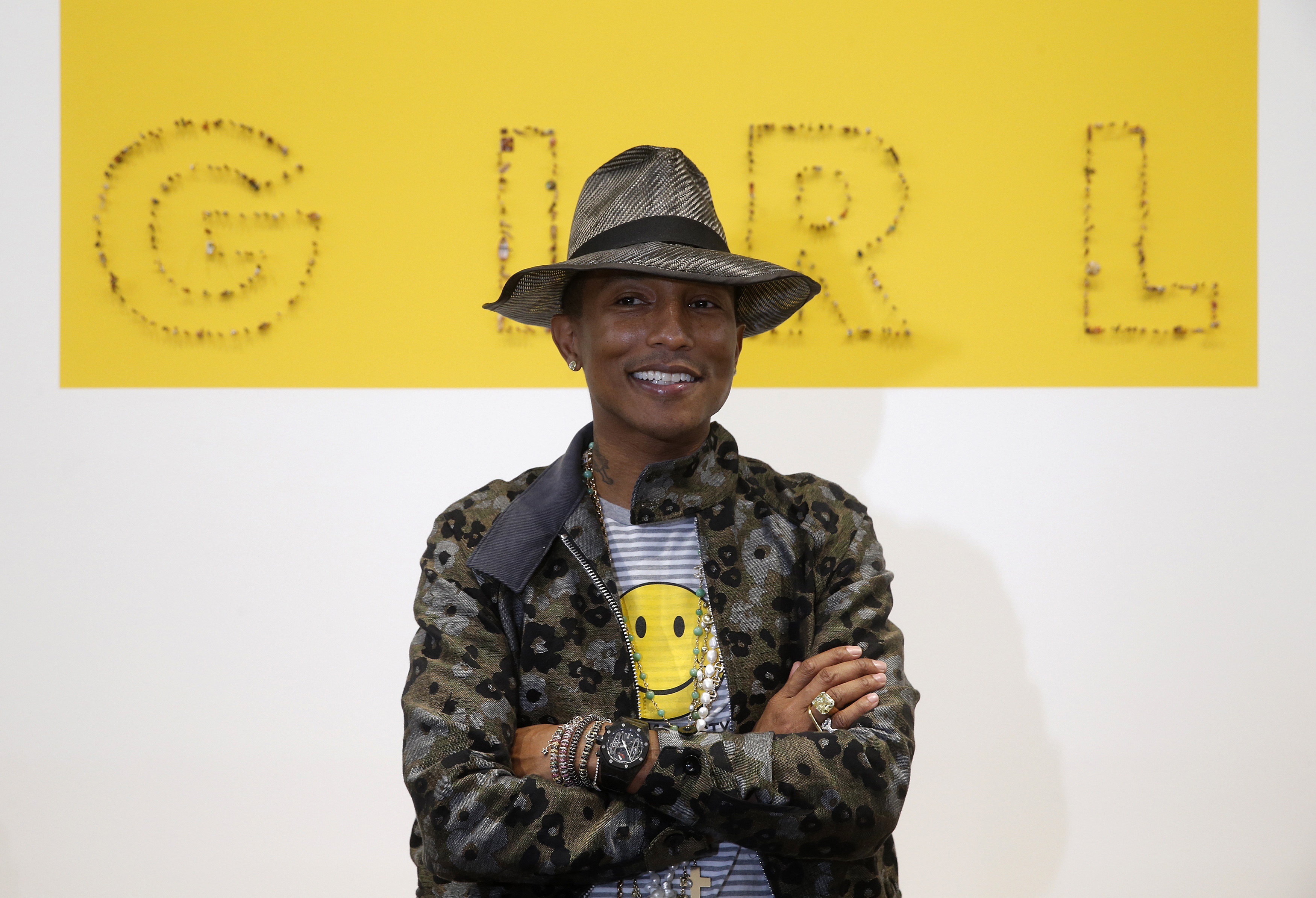 Singer Pharrell Williams poses during the opening of the exhibition  GIRL , with Pharrell Williams as its curator, at the Galerie Perrotin in Paris, May 26, 2014.