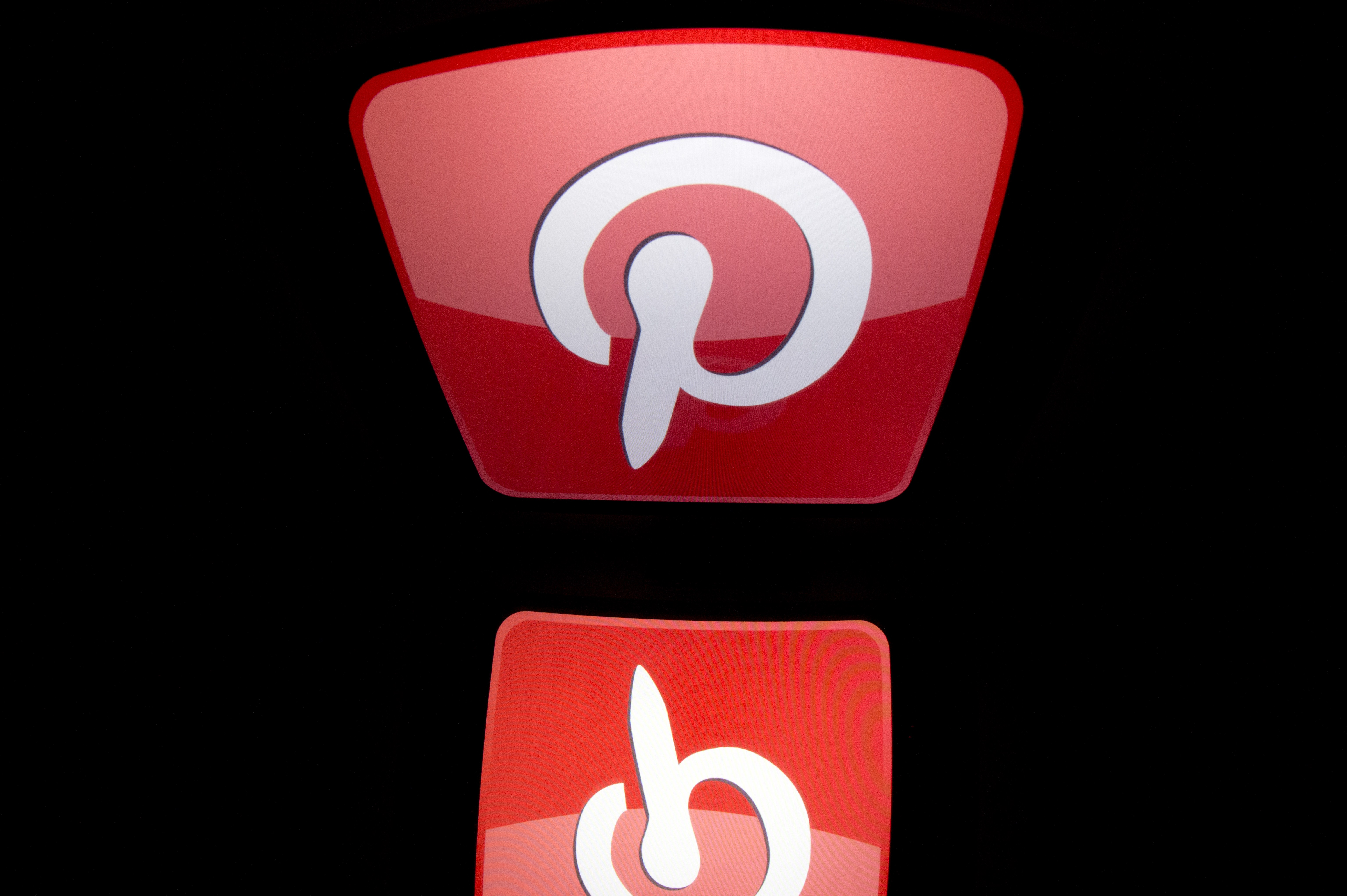 The logo of mobile app  Pinterest  is displayed on a tablet on Jan. 2, 2014 in Paris.