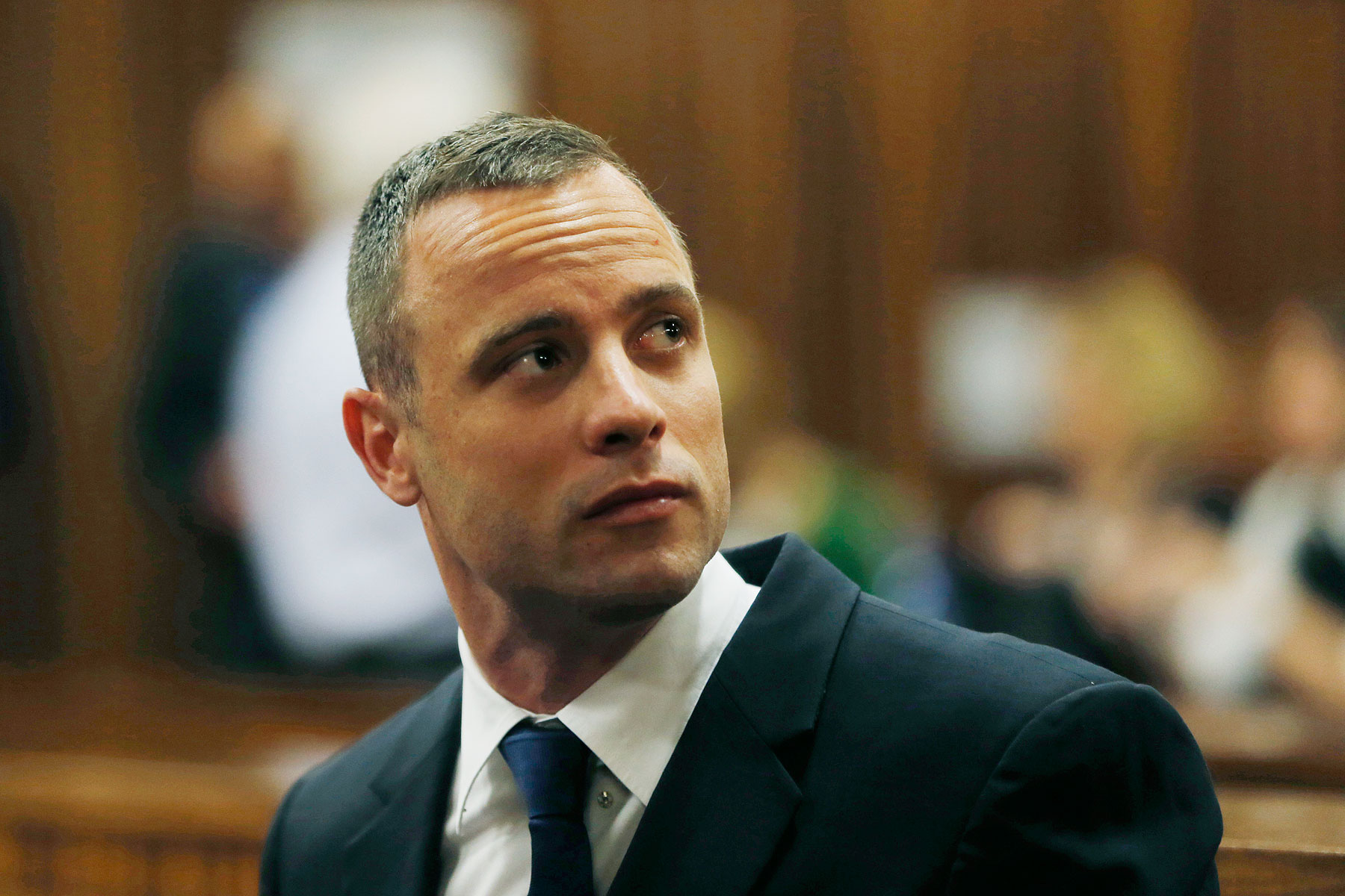 Oscar Pistorius is seated in a courtroom at the high court in Pretoria, South Africa, Tuesday, May 6, 2014