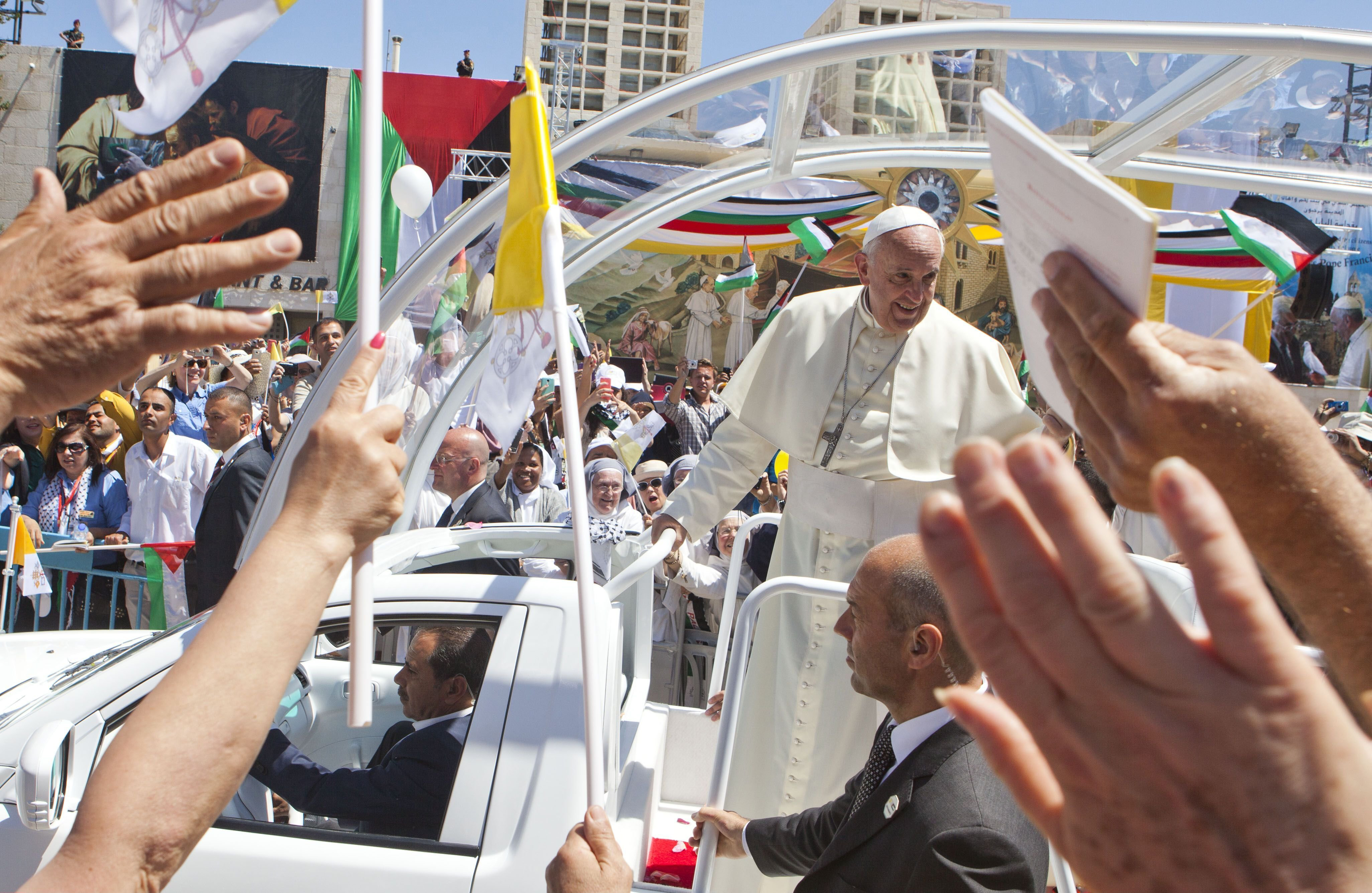 Pope Francis arrived in Bethlehem's Manger Square in an open vehicle where over 10,000 Christian pilgrims were packed on May 25, 2014 in the West Bank.