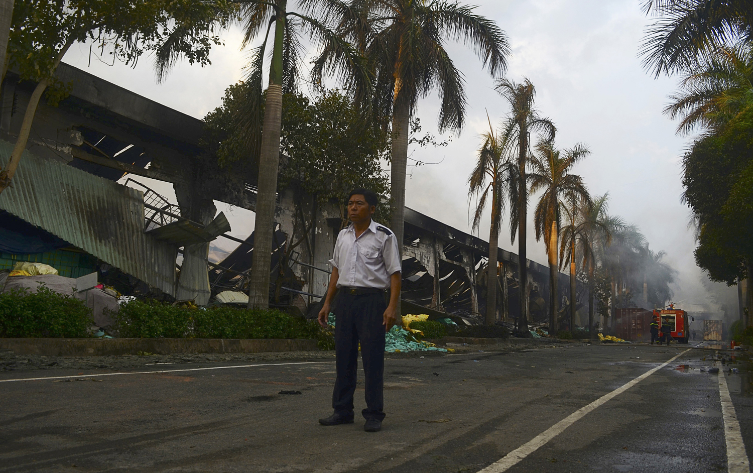 A security guard stands near a damaged Chinese owned shoe factory in Vietnam's southern Binh Duong province May 14, 2014.