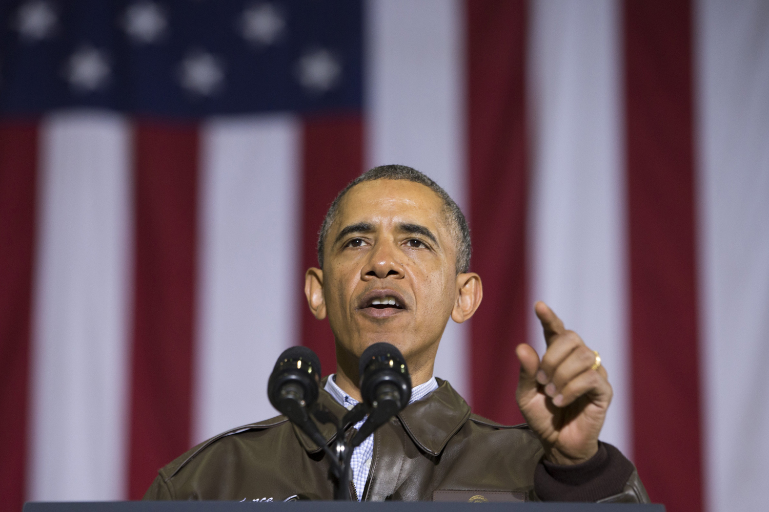 President Barack Obama gestures while speaking to troops at Bagram Air Field north of Kabul, Afghanistan, during an unannounced visit, May 25, 2014.
