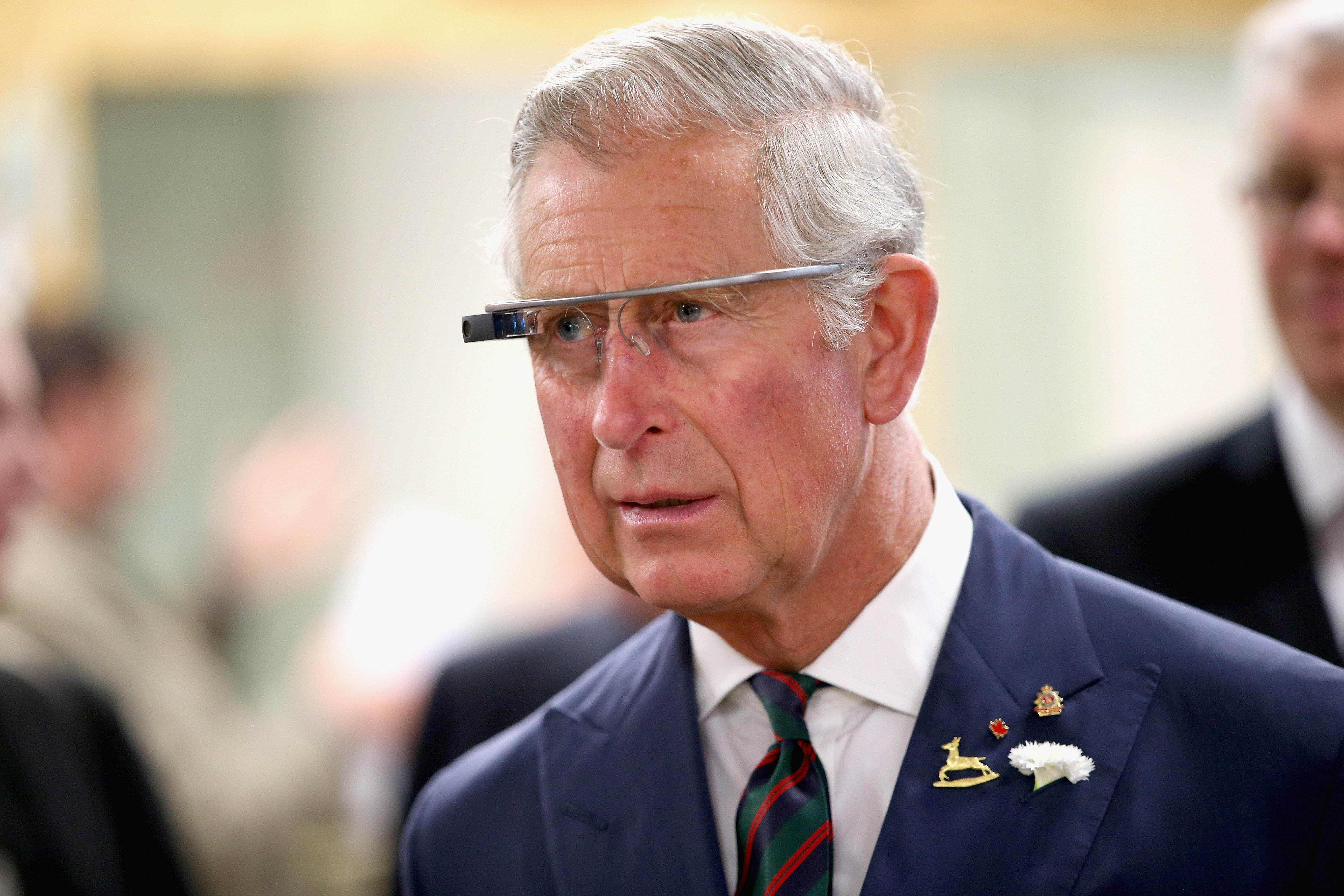 Prince Charles, Prince of Wales tries on 'Google Glass' spectacles as he visits 'Innovation Alley' on May 21, 2014 in Winnipeg, Canada.