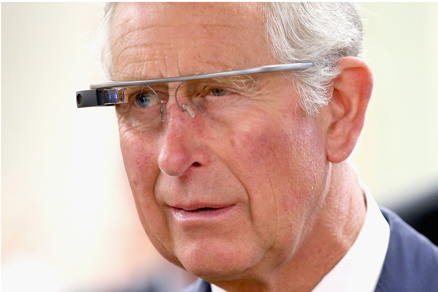 Prince Charles tries on 'Google Glass' spectacles as he visits 'Innovation Alley'  in Winnipeg, Canada on May 21, 2014.