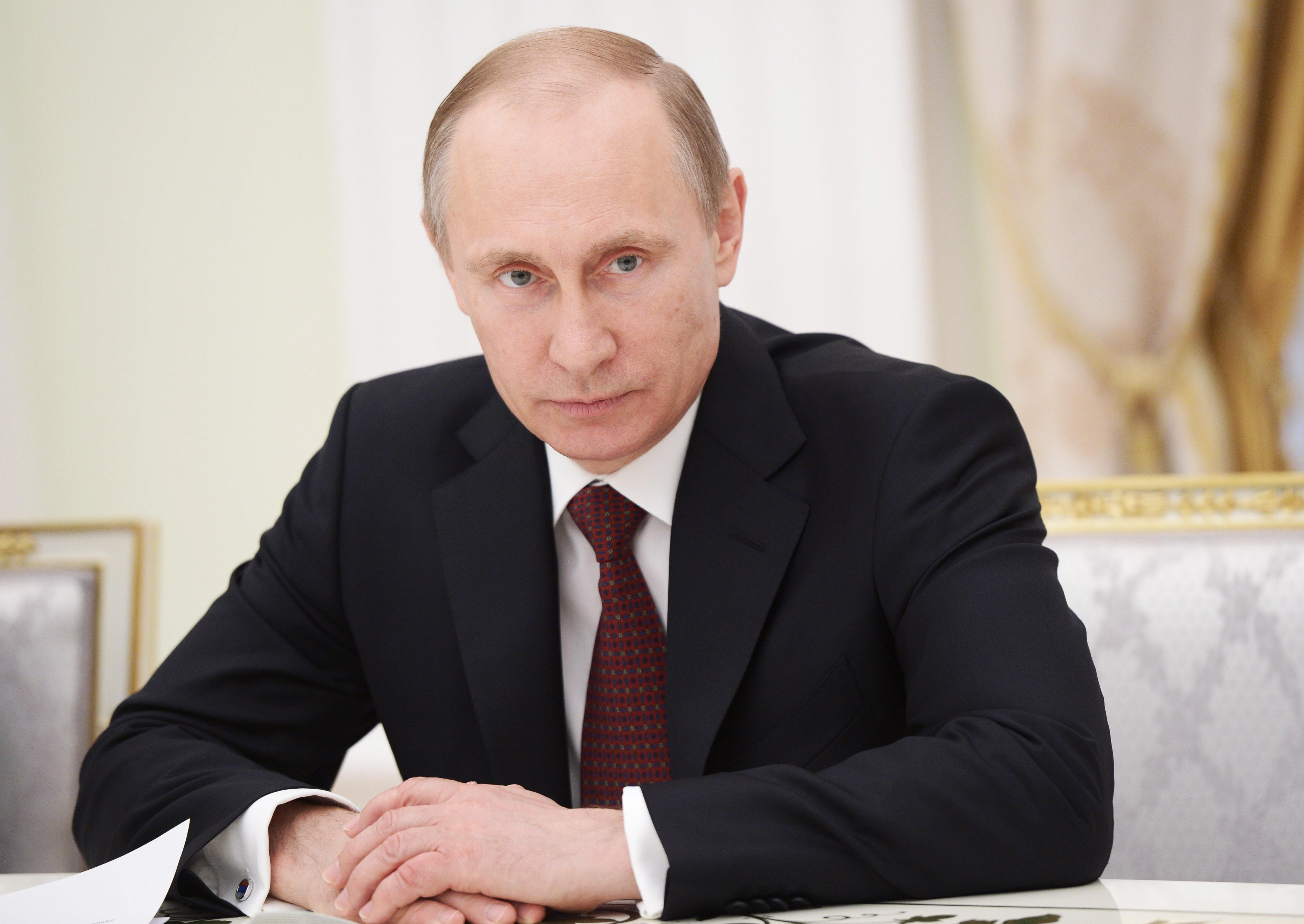 Russia's president Vladimir Putin at a meeting with representatives of the Federation of Independent Trade Unions of Russia in Moscow on May 1, 2014.