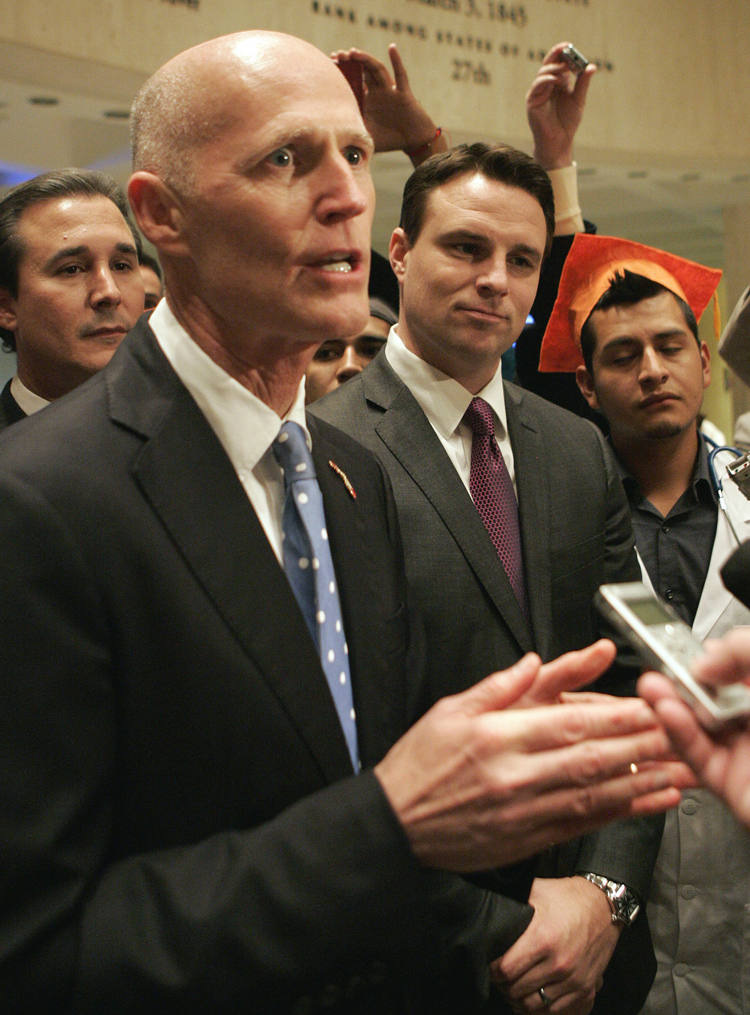 Gov. Rick Scott, left, and house speaker Will Weatherford speak at a news conference after session on Thursday, May 1, 2014, in Tallahassee, Fla.