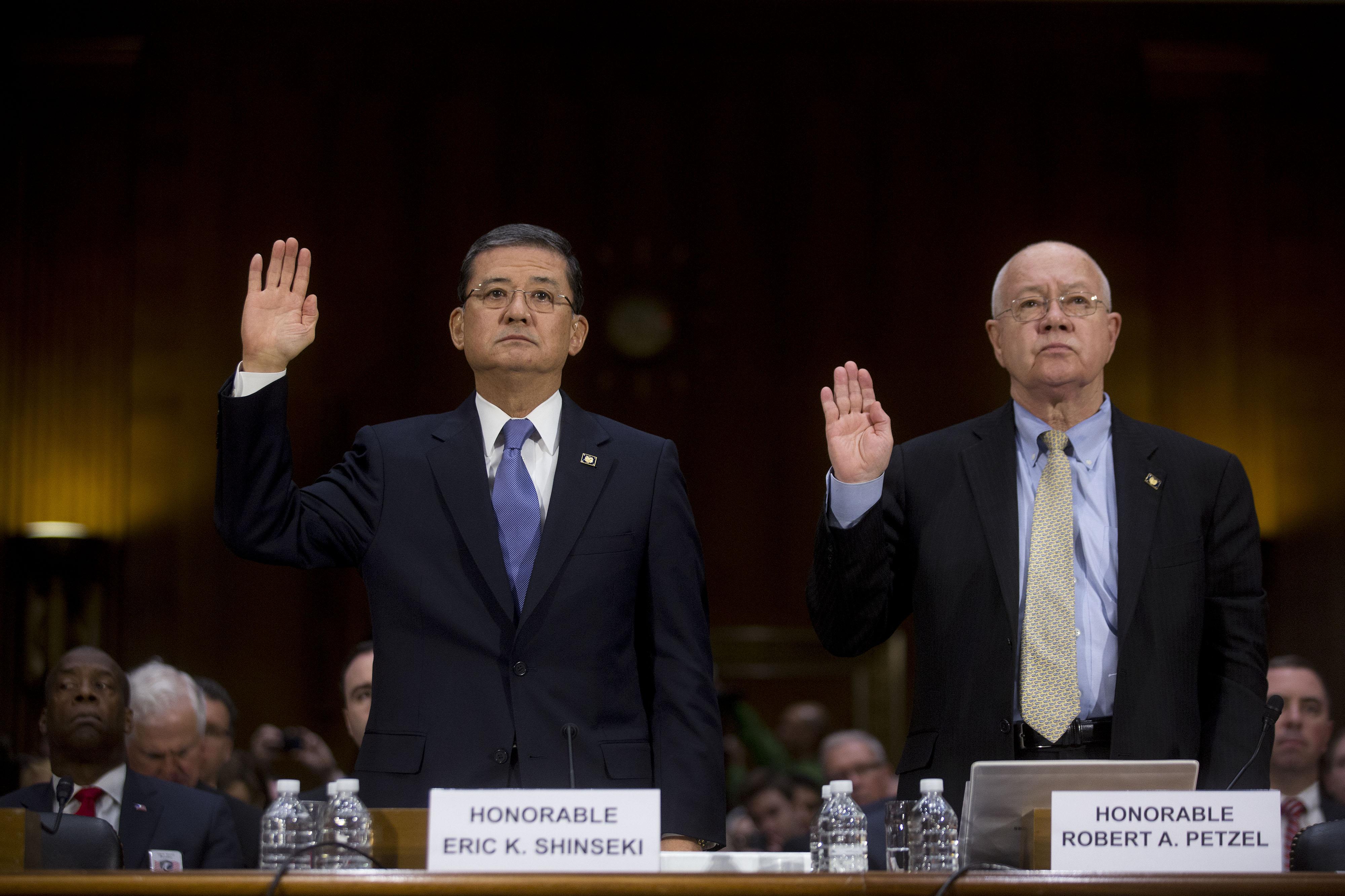 Eric Shinseki, U.S. secretary of Veterans Affairs (VA), left, and Robert Petzel, U.S. VA undersecretary for health, swear in to a Senate Veterans' Affairs Committee hearing in Washington, May 15, 2014.