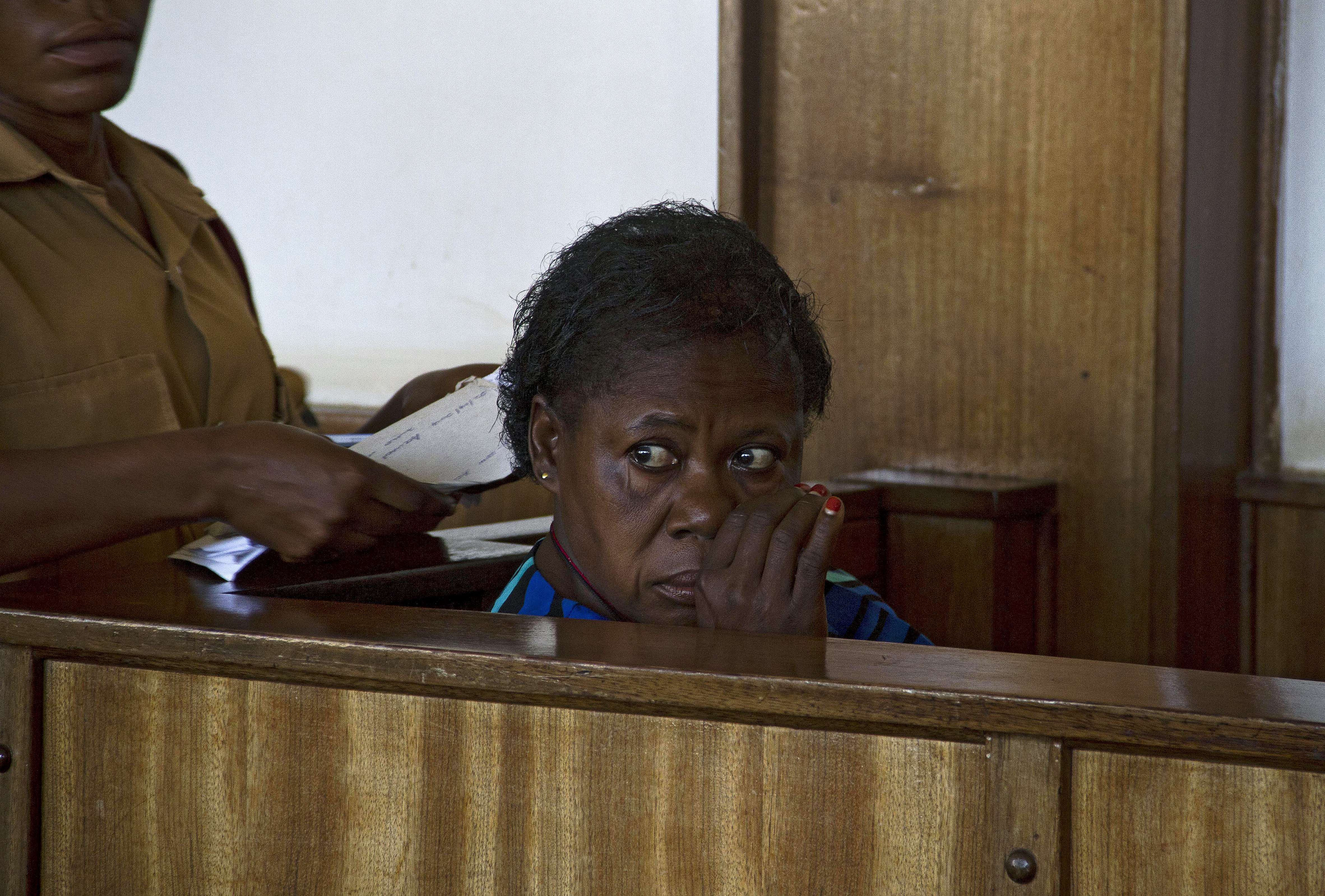 Ugandan nurse Rosemary Namubiru sits at the dock at the Buganda Road Magistrates Court on May 19, 2014 in Kampala during a ruling on a case where she was charged with  Criminal Negligence  and sentenced to 3 years in prison after she was found guilty by the Ugandan court.