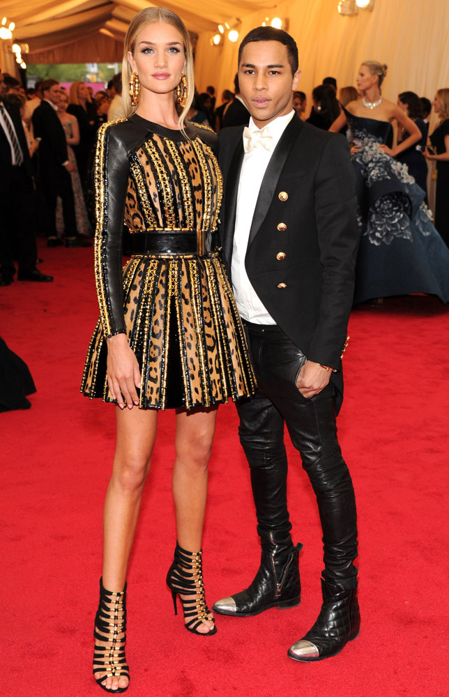 From left: Rosie Huntington Whiteley and Olivier Rousteing attend the  Charles James: Beyond Fashion  Costume Institute Gala at the Metropolitan Museum of Art on May 5, 2014 in New York City.