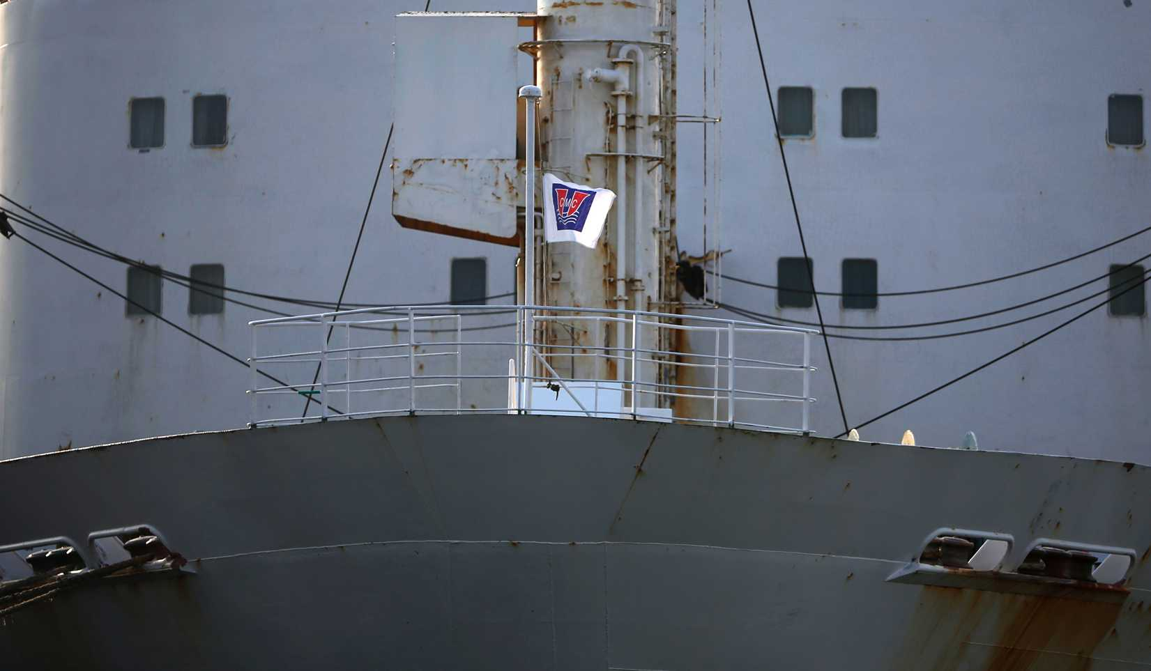 A flag depicting the company logo of Chonghaejin Marine Co flutters on its ferry Ohamana at Incheon Port Passenger Terminal in Incheon April 22, 2014.