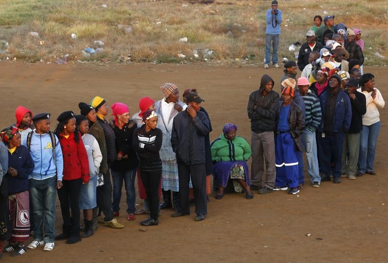 Voters queue to cast their ballots in the election in Bekkersdal near Johannesburg on May 7, 2014.