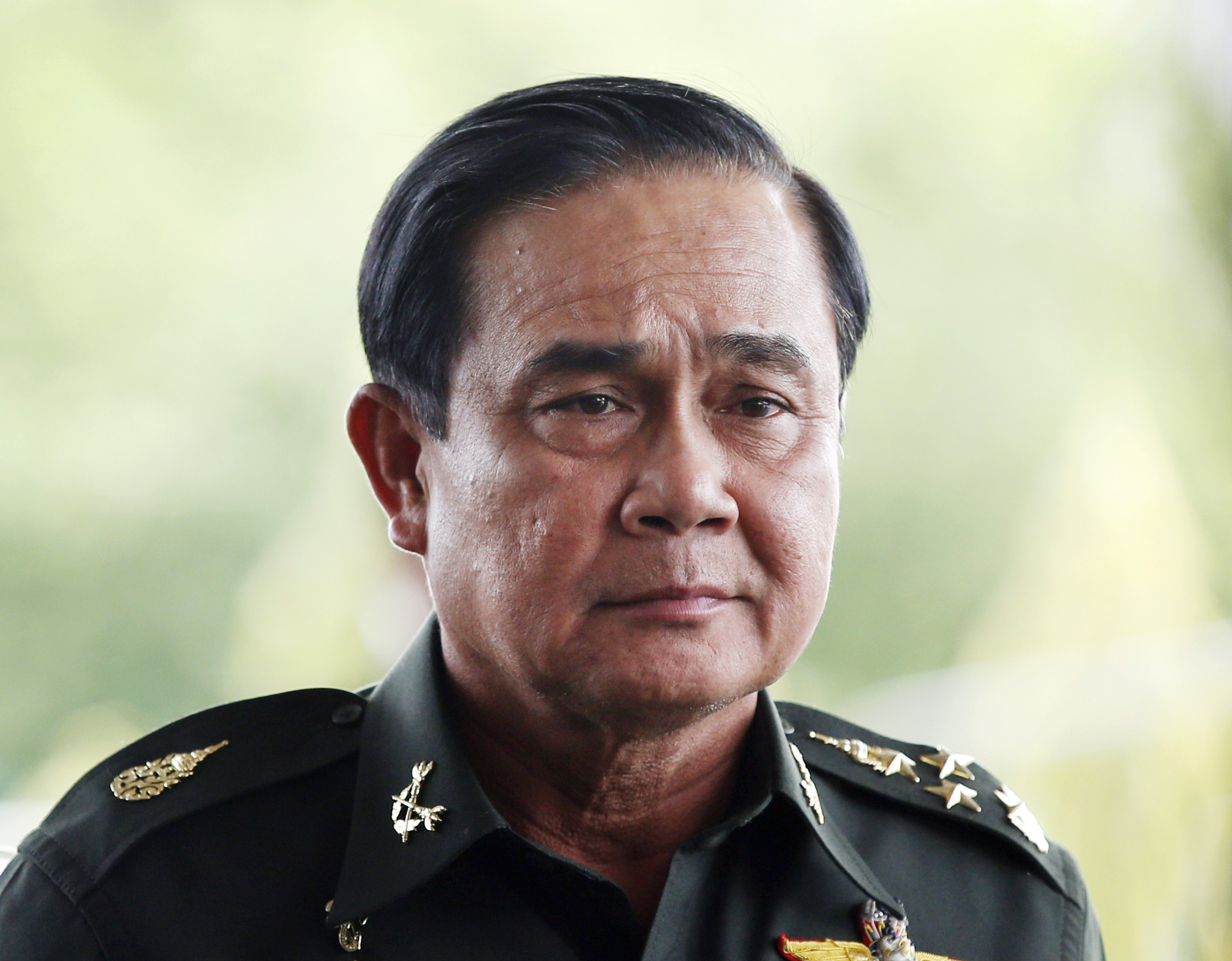Thai army chief General Prayuth Chan-ocha arrives to give a news conference at the Army Club in Bangkok on May 20, 2014