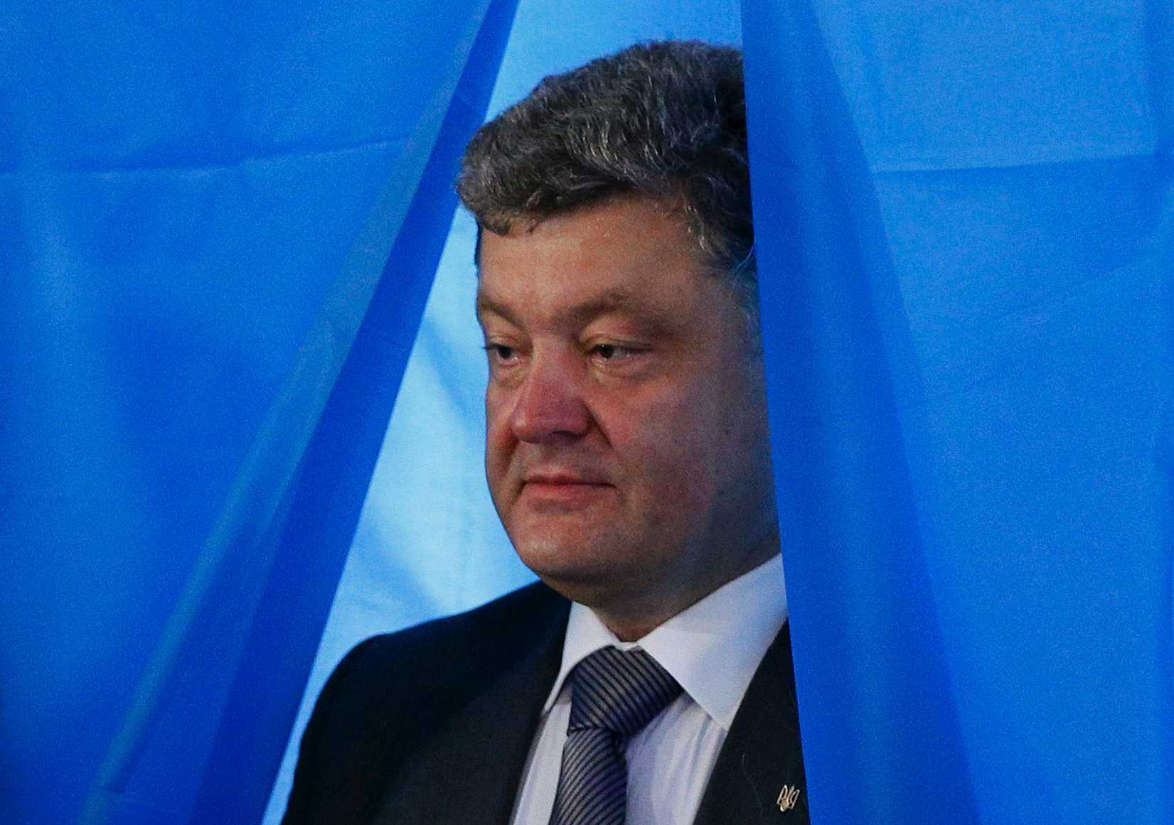 Ukrainian businessman, politician and presidential candidate Petro Poroshenko leaves a booth before casting his vote at a polling station in Kiev on May 25, 2014