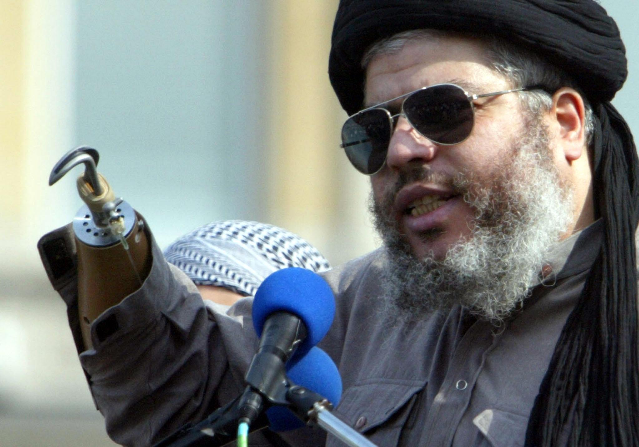 Radical Islamist cleric Abu Hamza al-Masri addresses an                   annual rally for Islam in Trafalgar Square, London, on Aug. 25, 2002